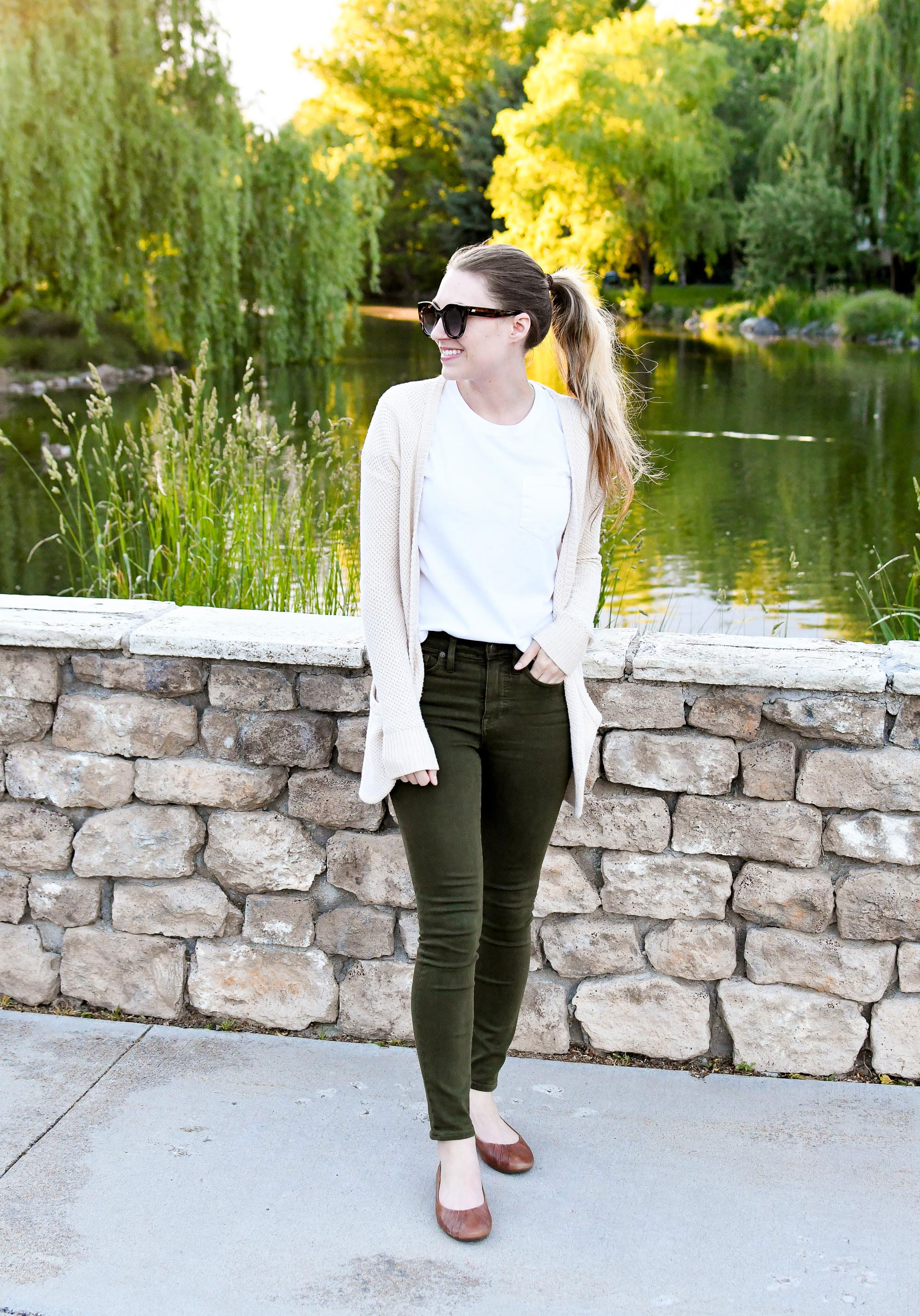 Olive green jeans casual spring outfit with white tee — Cotton Cashmere Cat Hair