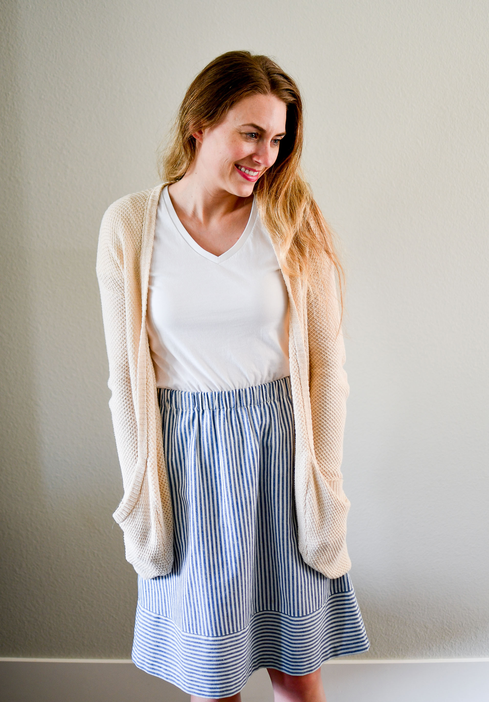 Cream cardigan, white tee, blue striped skirt summer work outfit — Cotton Cashmere Cat Hair