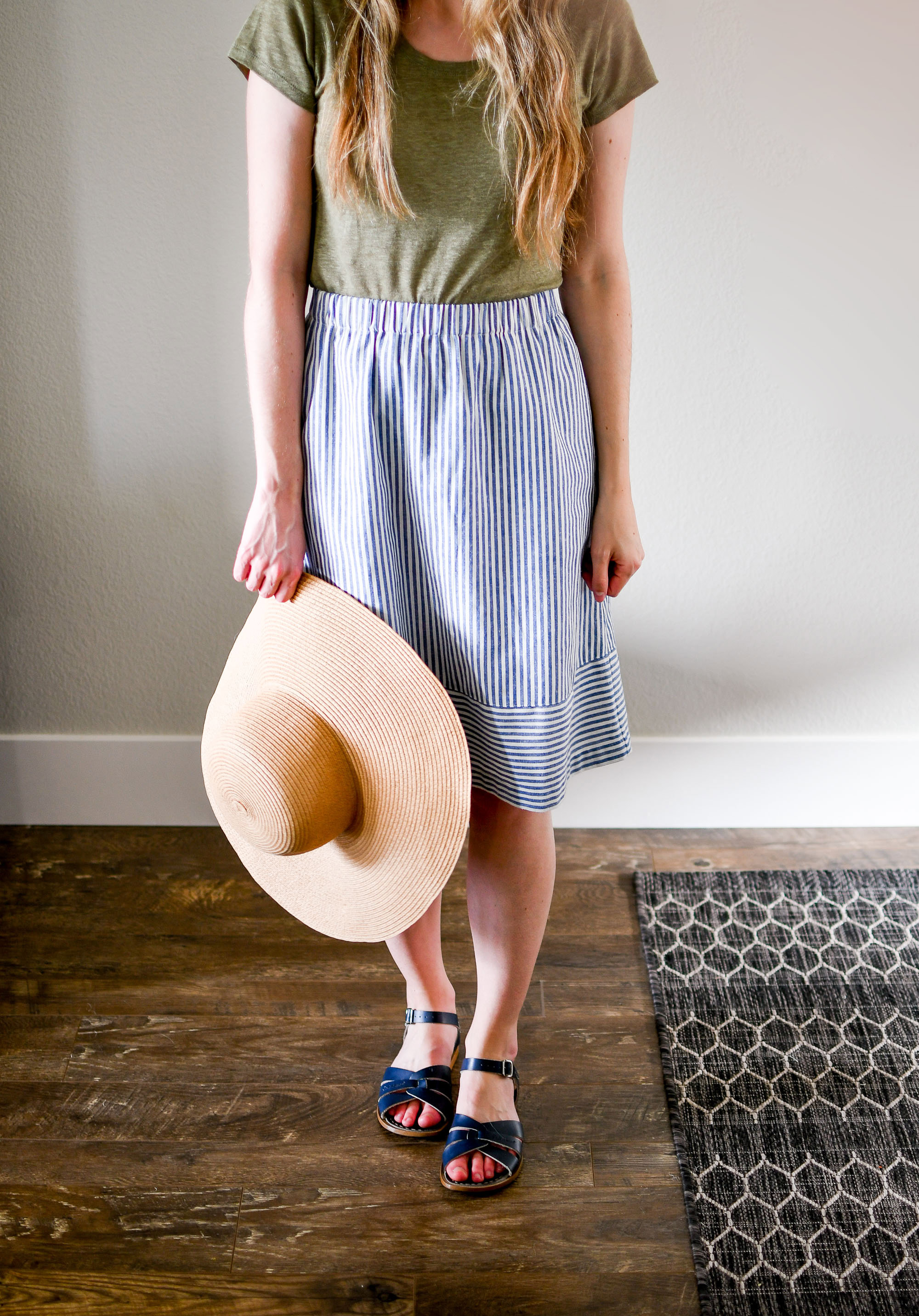 Straw sun hat outfit with striped skirt — Cotton Cashmere Cat Hair