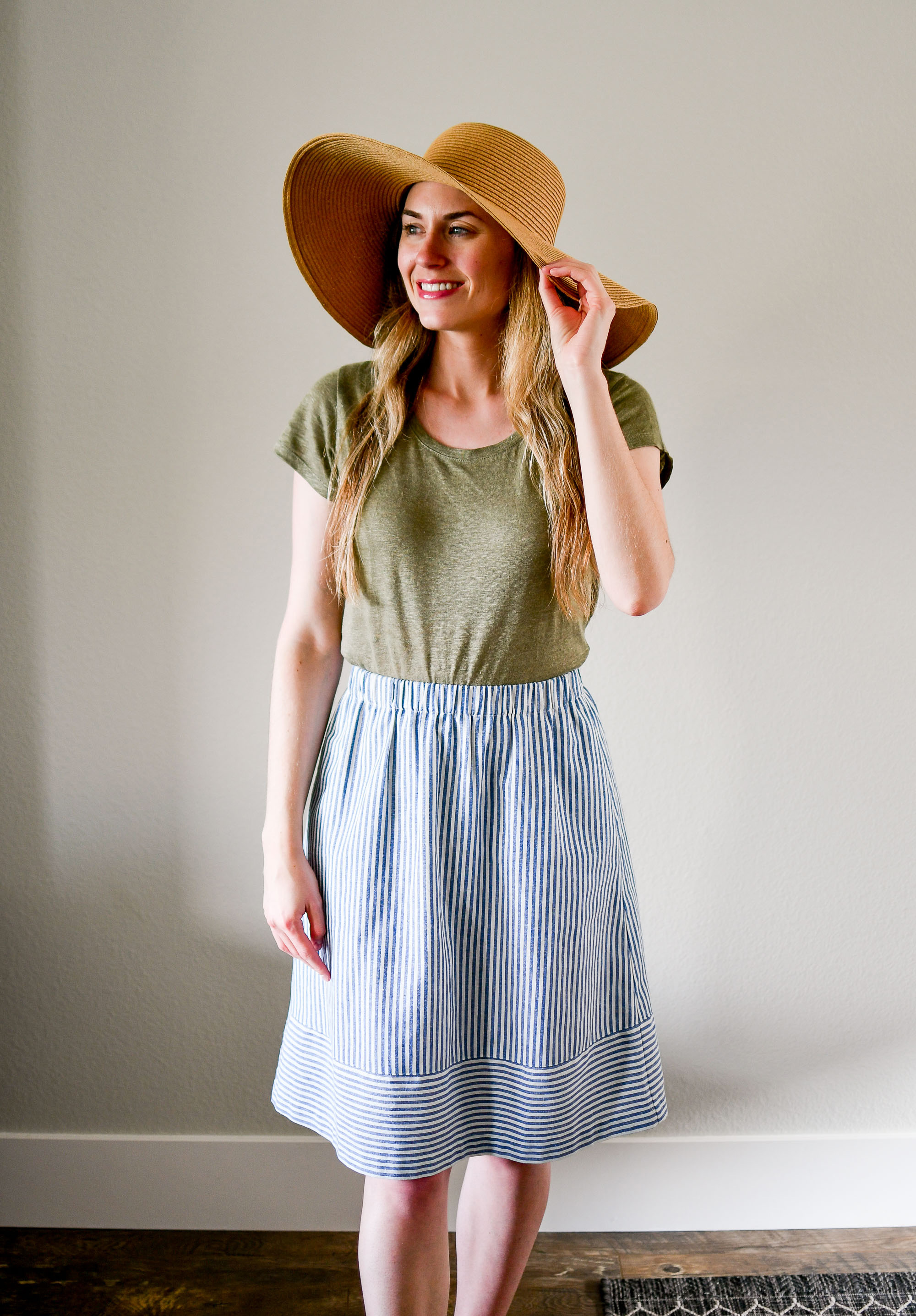 Straw sun hat, green linen tee, striped midi skirt — Cotton Cashmere Cat Hair