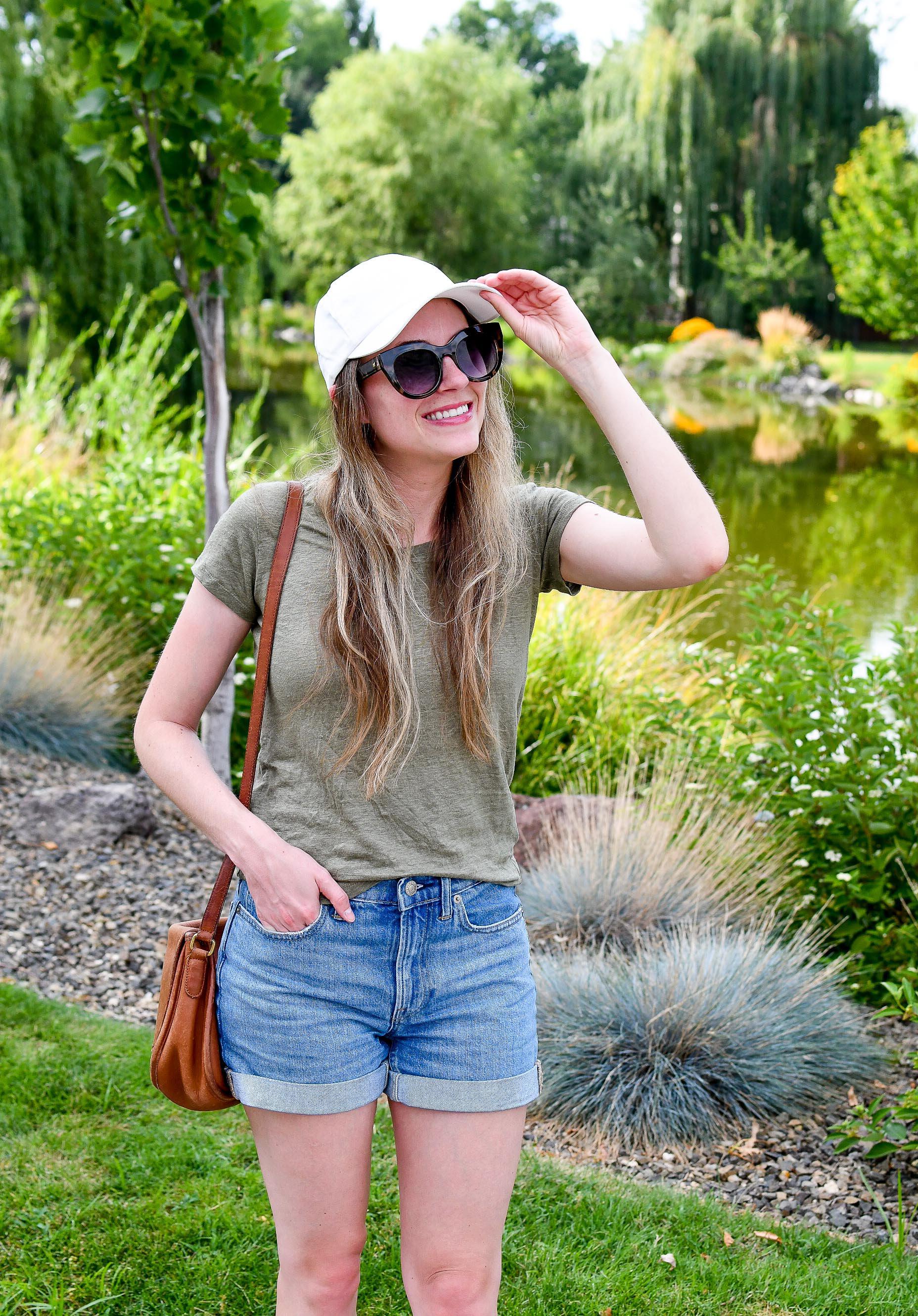Everlane baseball cap, linen tee, denim shorts casual summer outfit — Cotton Cashmere Cat Hair