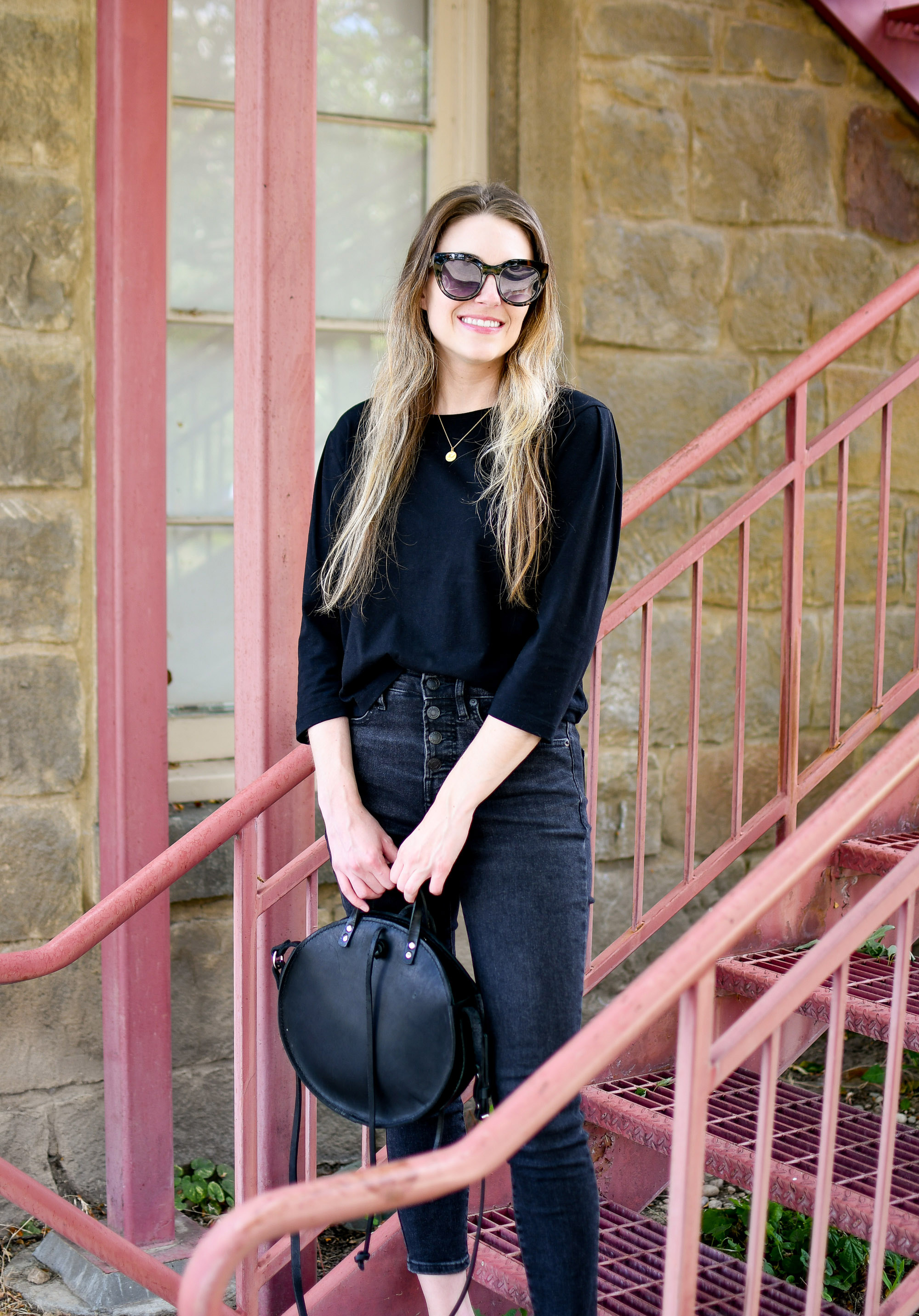 Black circle crossbody bag summer outfit — Cotton Cashmere Cat Hair
