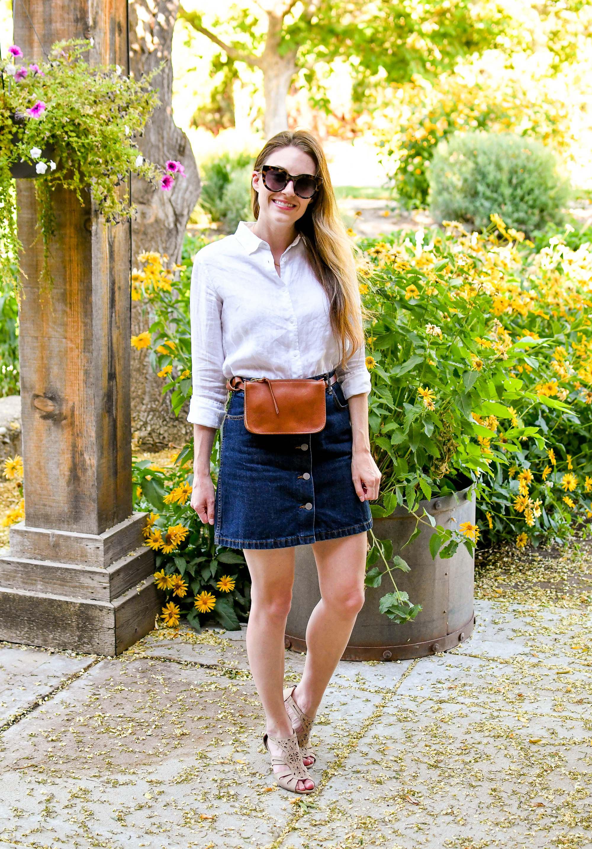 Denim skirt summer outfit with linen shirt, belt bag, beige sandals — Cotton Cashmere Cat Hair