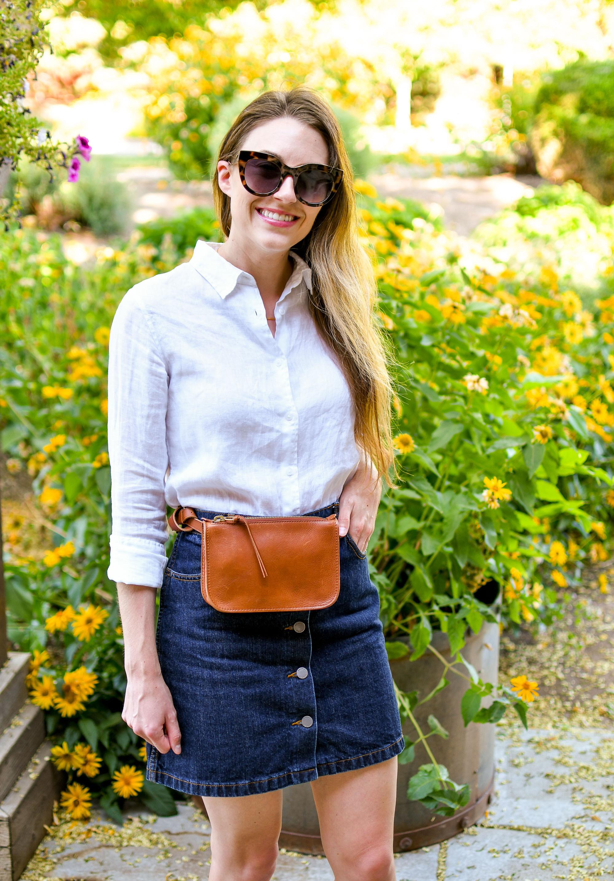 White linen shirt, denim mini skirt, cognac belt bag — Cotton Cashmere Cat Hair