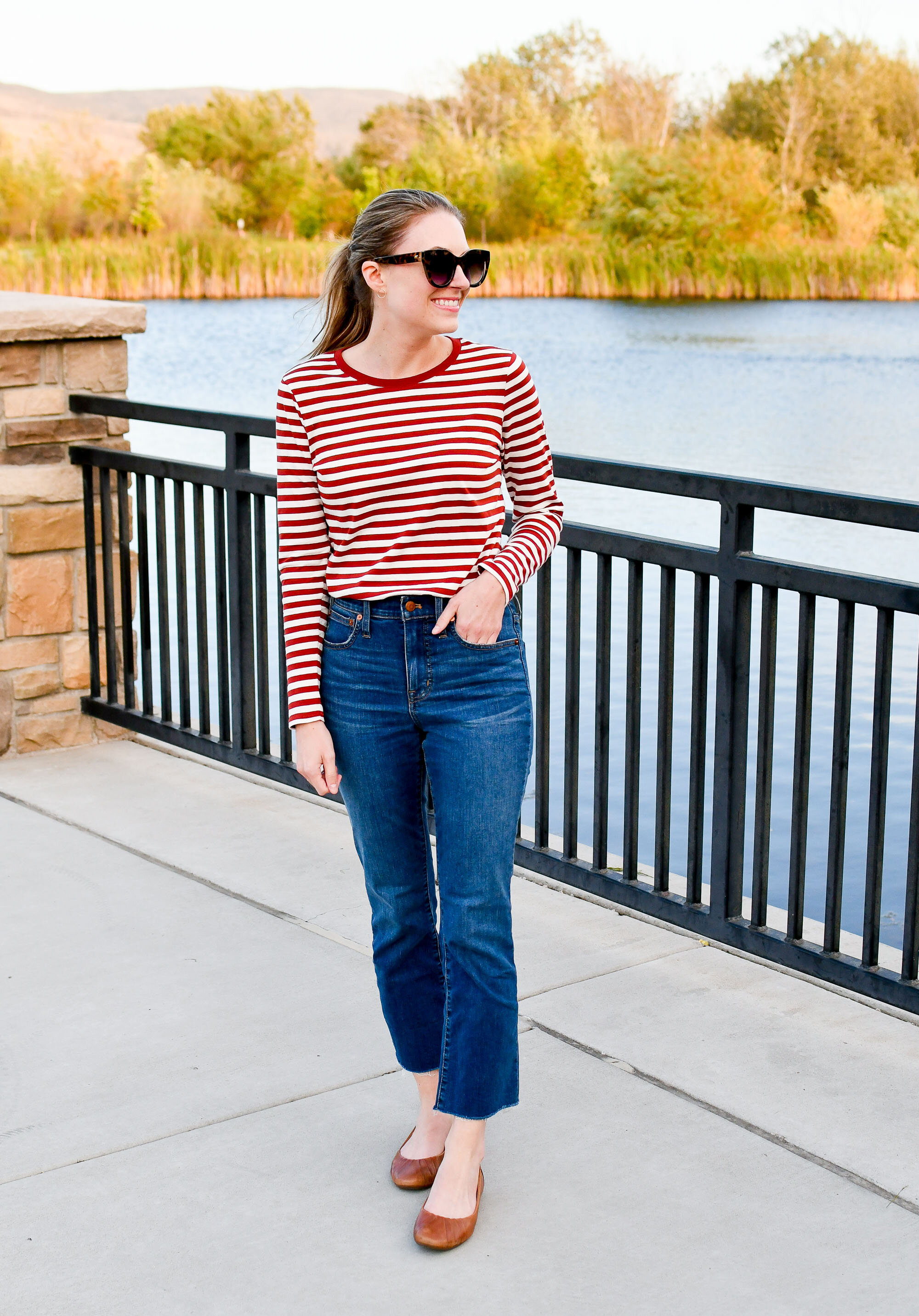 Casual fall outfit with red striped tee, demi-boot jeans, brown flats — Cotton Cashmere Cat Hair