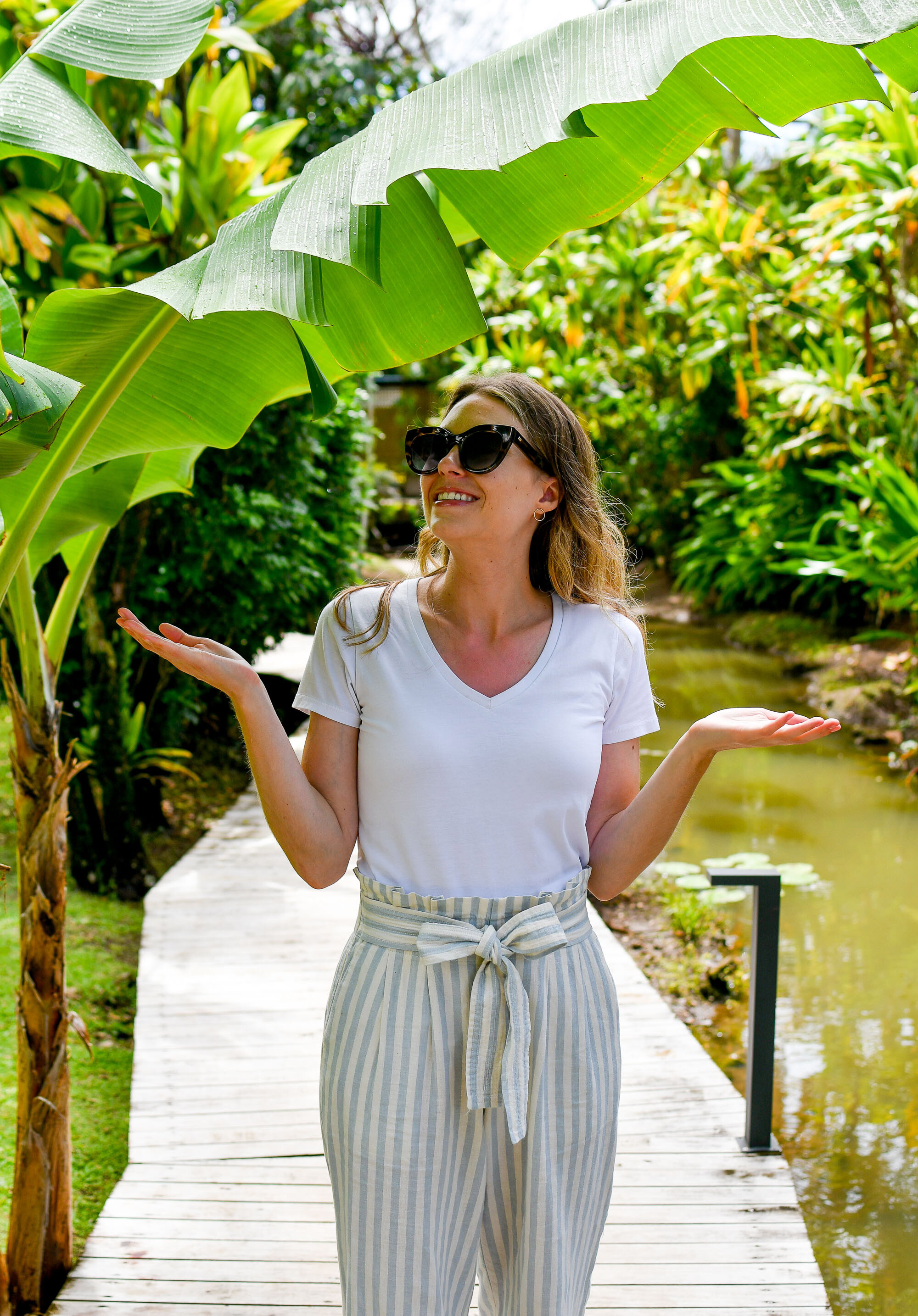 Standing under a palm tree on Rarotonga, Cook Islands — Cotton Cashmere Cat Hair