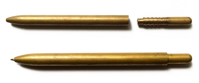 Photo from maker's Kickstarter showing the original brass USSR-made pen that this pen was styled after.