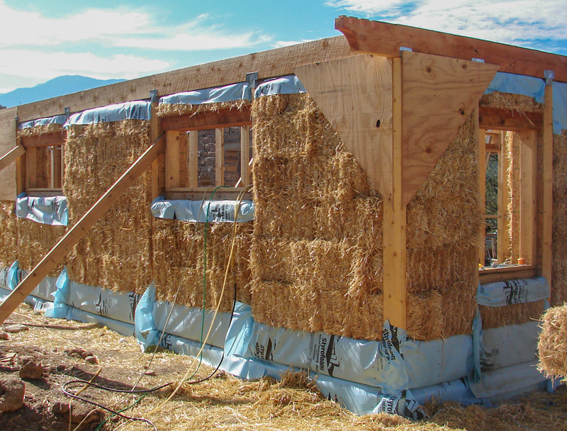 Strawbale exterior corner wall under construction.