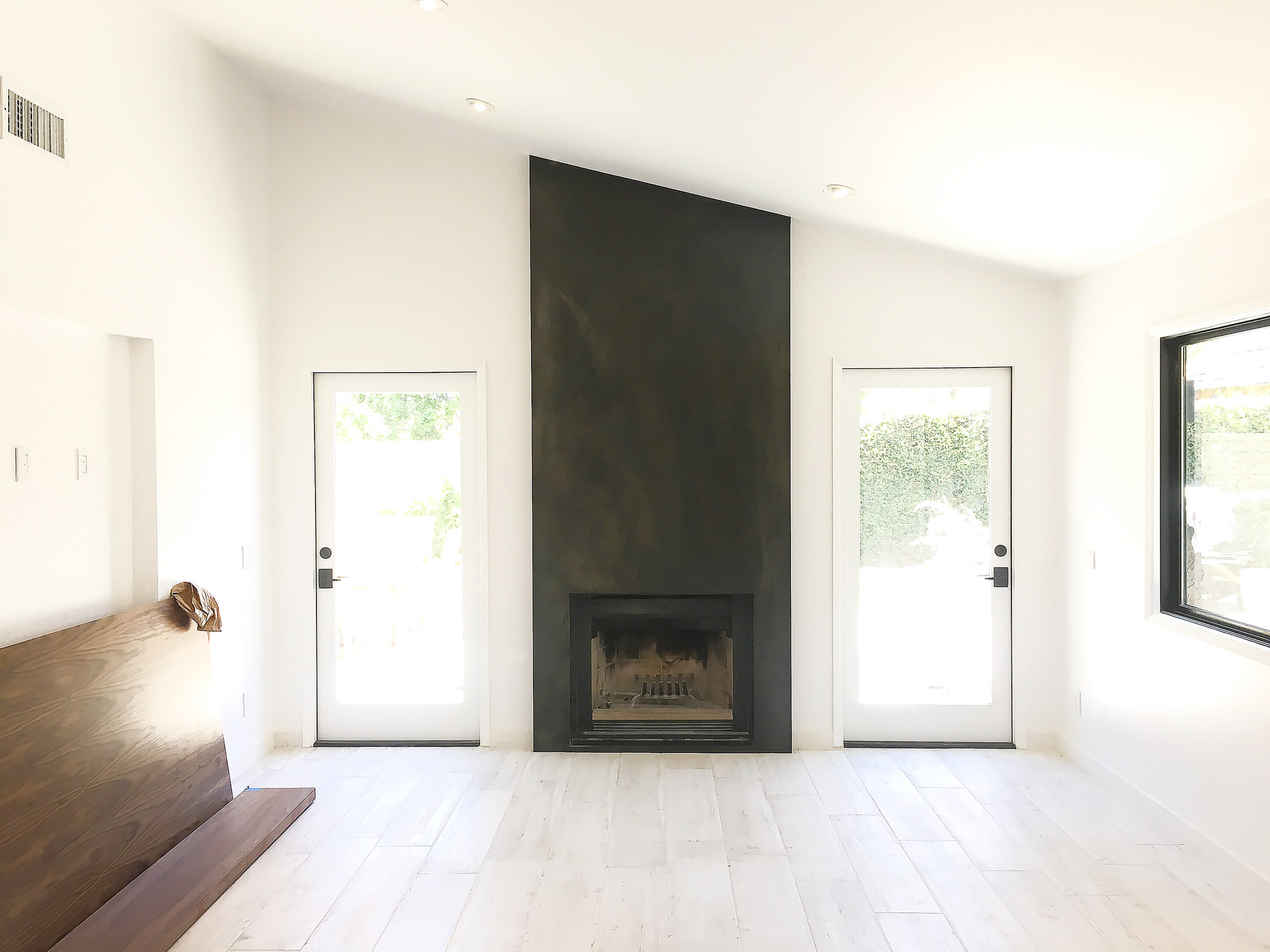 Fireplace surround with floor installed.jpg