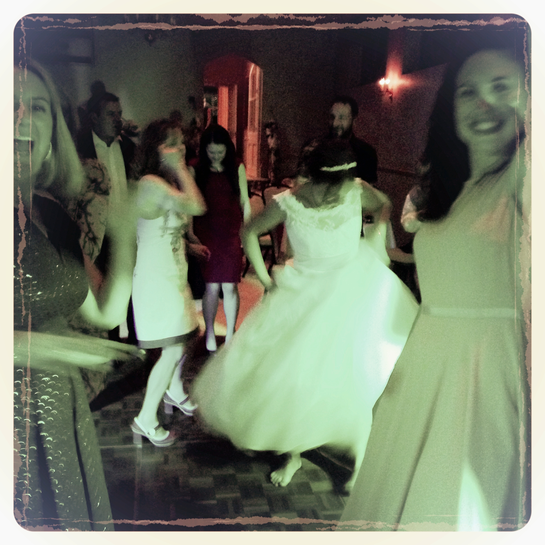 Bride enjoying the live music on the dance floor, Little Horsted