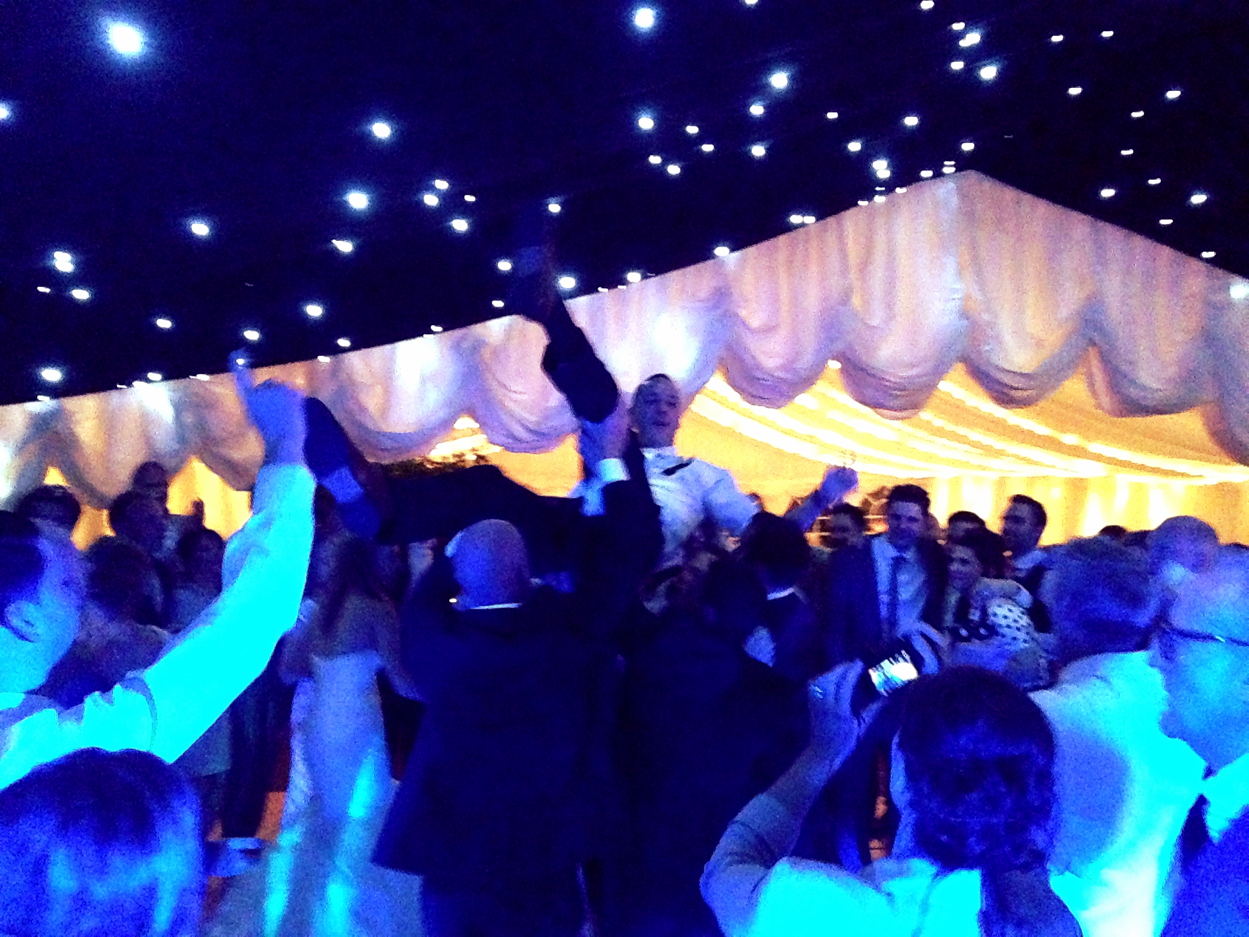 David the Groom gets a lift on the full dance floor!! Kate & David's wedding, Fryerning Essex