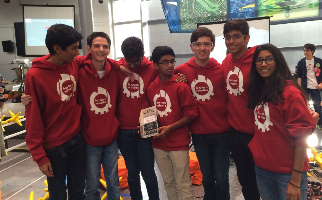 Team 765X is shown with the Judges Award, which is presented to a team based on their design (specifically their anti-tip and lift designs) as well as each member having specialized knowledge on each part of the robot.