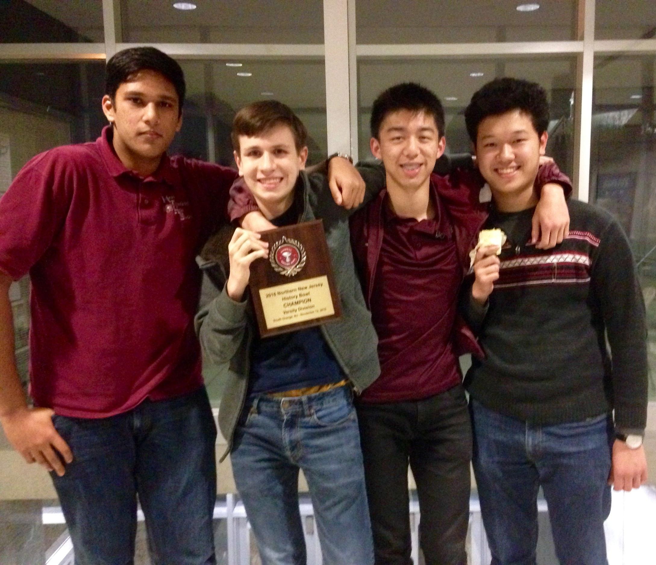 Gaurav Sharma, Douglas Simons, Kevin Lu, and Samuel Kao celebrate their victory.