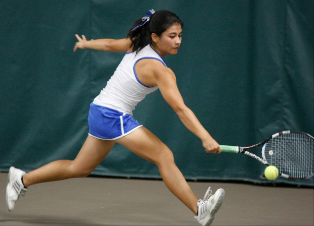 Rita Vought uses her strong backhand to return a shot.