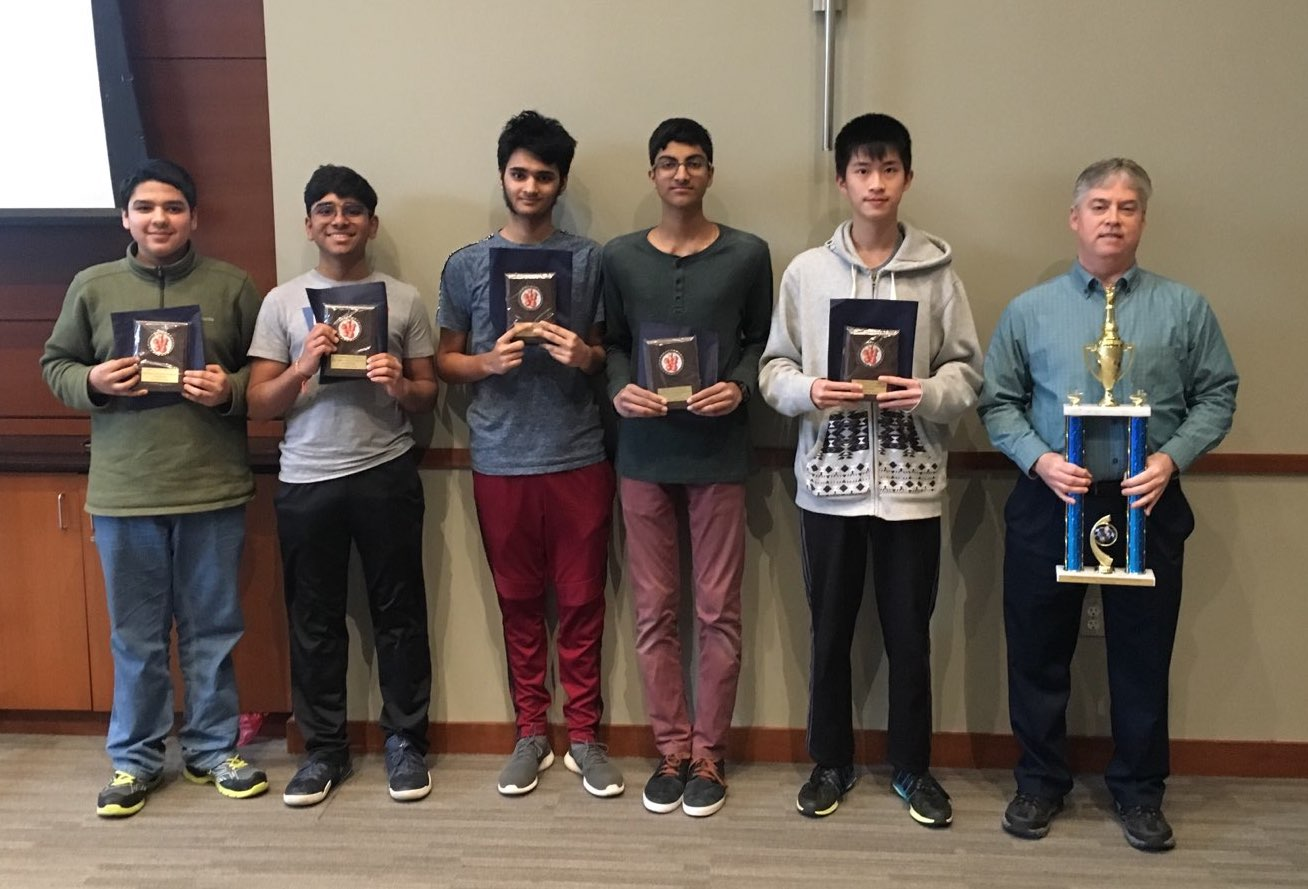 The Chess Team Members are (L to R): Hazem Zaky, Mayank Barad, Pranav Gaka, Abhinav Ramidi, Jason Yan, and Coach John Bartlett
