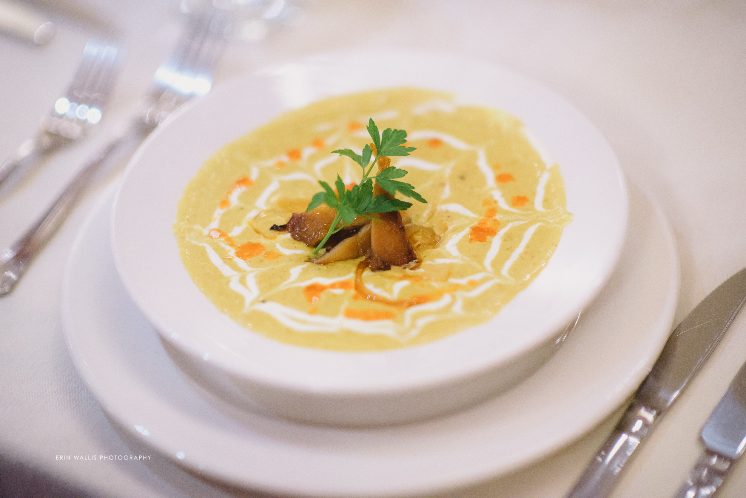 Yellow madras coconut curried corn bisque, melted leek & bell pepper fondue, Fleurer's hot smoked sable fish, creme fraiche & chili oil.