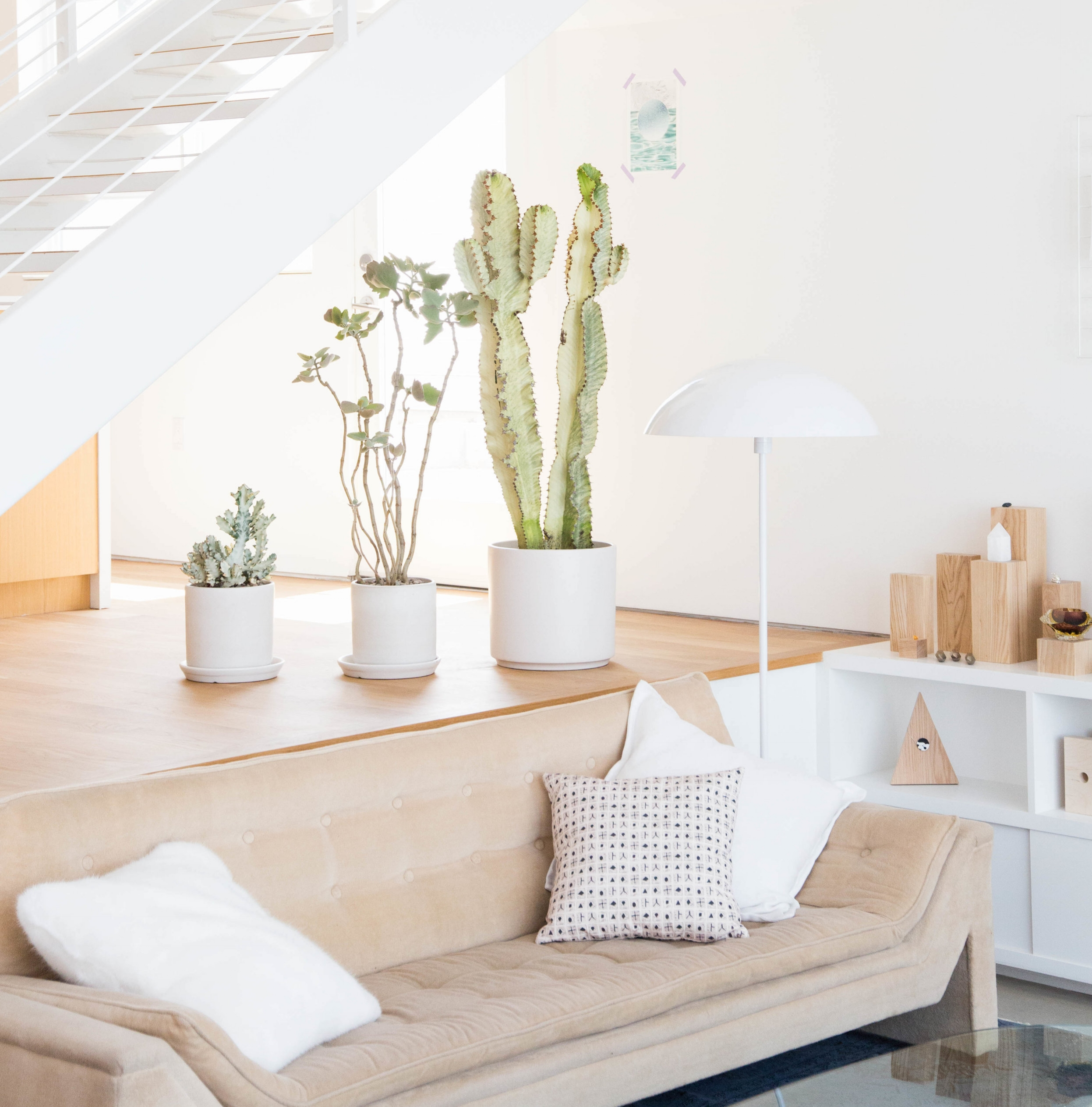 stefanistein-interior-design-jewelry-motif-modern-neutrals-showroom-retail-office-commercial-gondola-sofa-mydomaine-white-minimal