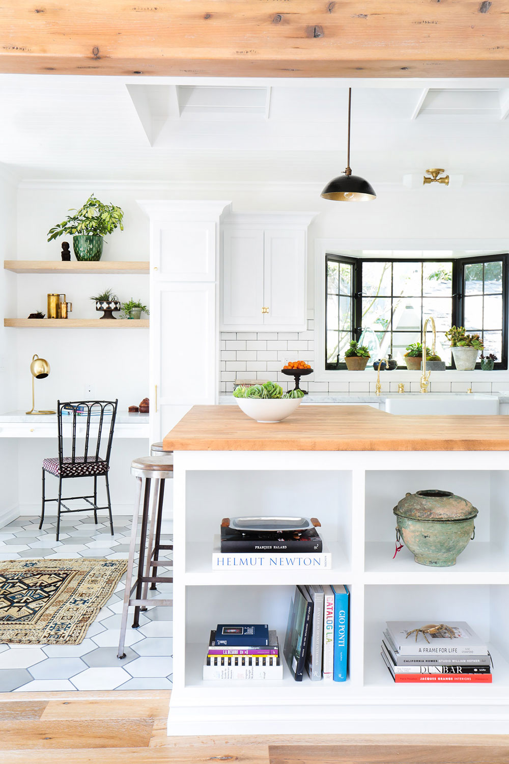 35 Bright California-Style Kitchens - Gleaming white surfaces, plenty of raw woods, and enviable natural light—these are some of the defining characteristics of a California-style kitchen. Whether these spaces are in the Golden State or not, they all share the same enviable design motif that's sure to cheer up any visitor (or home chef). Browse through 35 of our favorites.