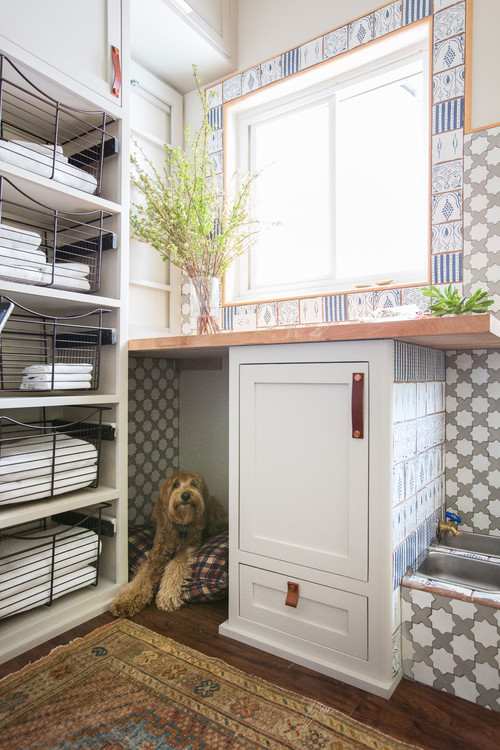12 Trending Decorating Tips To Try This Week - by Mitchell ParkerDon't forget pet-friendly design. There are a lot of great ideas in this 63-square-foot laundry room, but one way it really stands out is through its pet-friendly features. Here, a dog bed provides a cozy spot for the family pooch, while to the right of the cabinet sits a water station. The cabinet holds dog food, while the drawer pulls out to reveal food bowls.