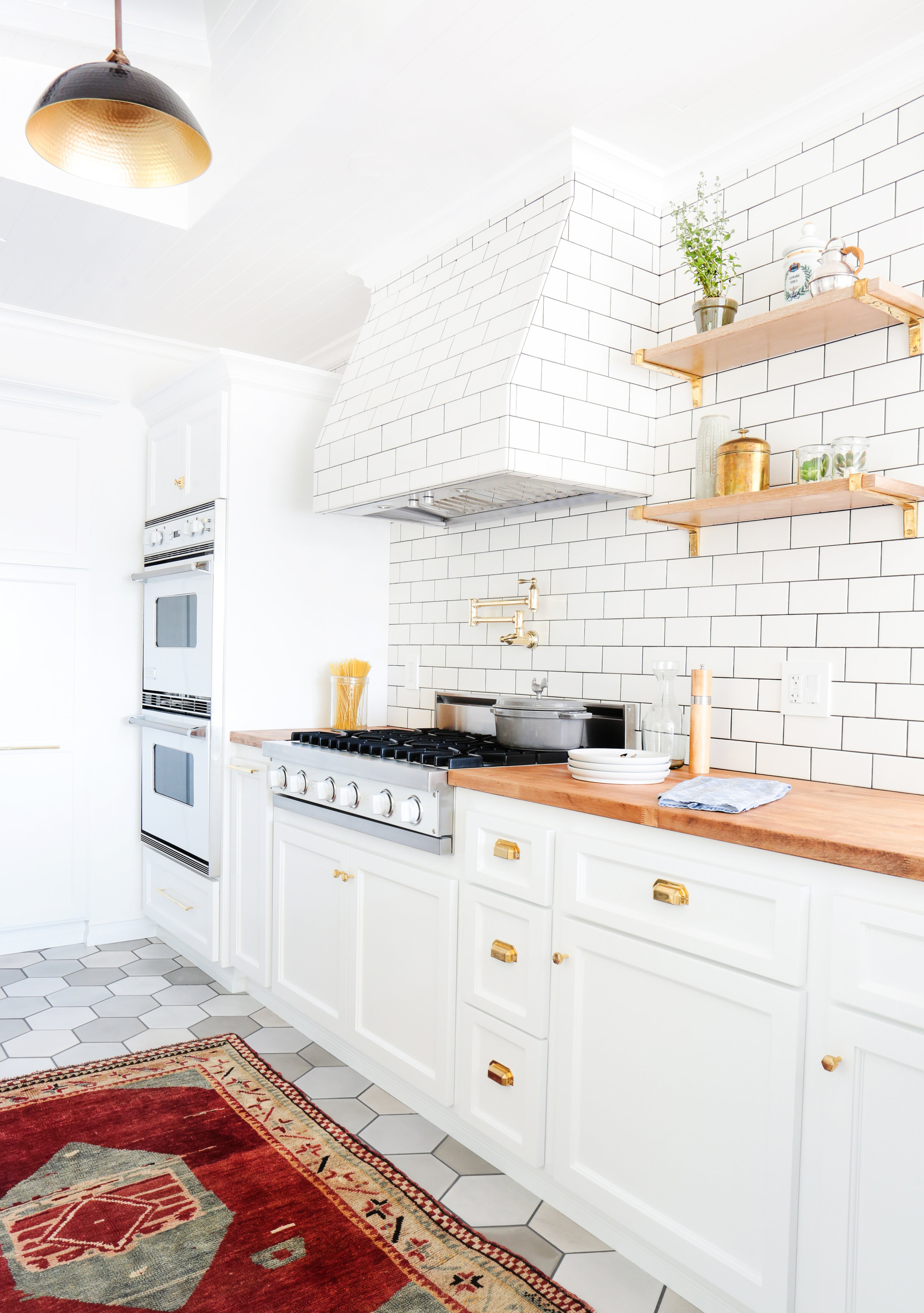 50 White Kitchen Cabinets To Brighten Up Your Cooking Space - Kitchen Cabinet Door Ideas - From sleek to country chic, we've got every style covered. BY KARA LADD  Bohemian ChicAccessorize with striking gold hardware for a glam touch.Design by Stefani Stein Inc.