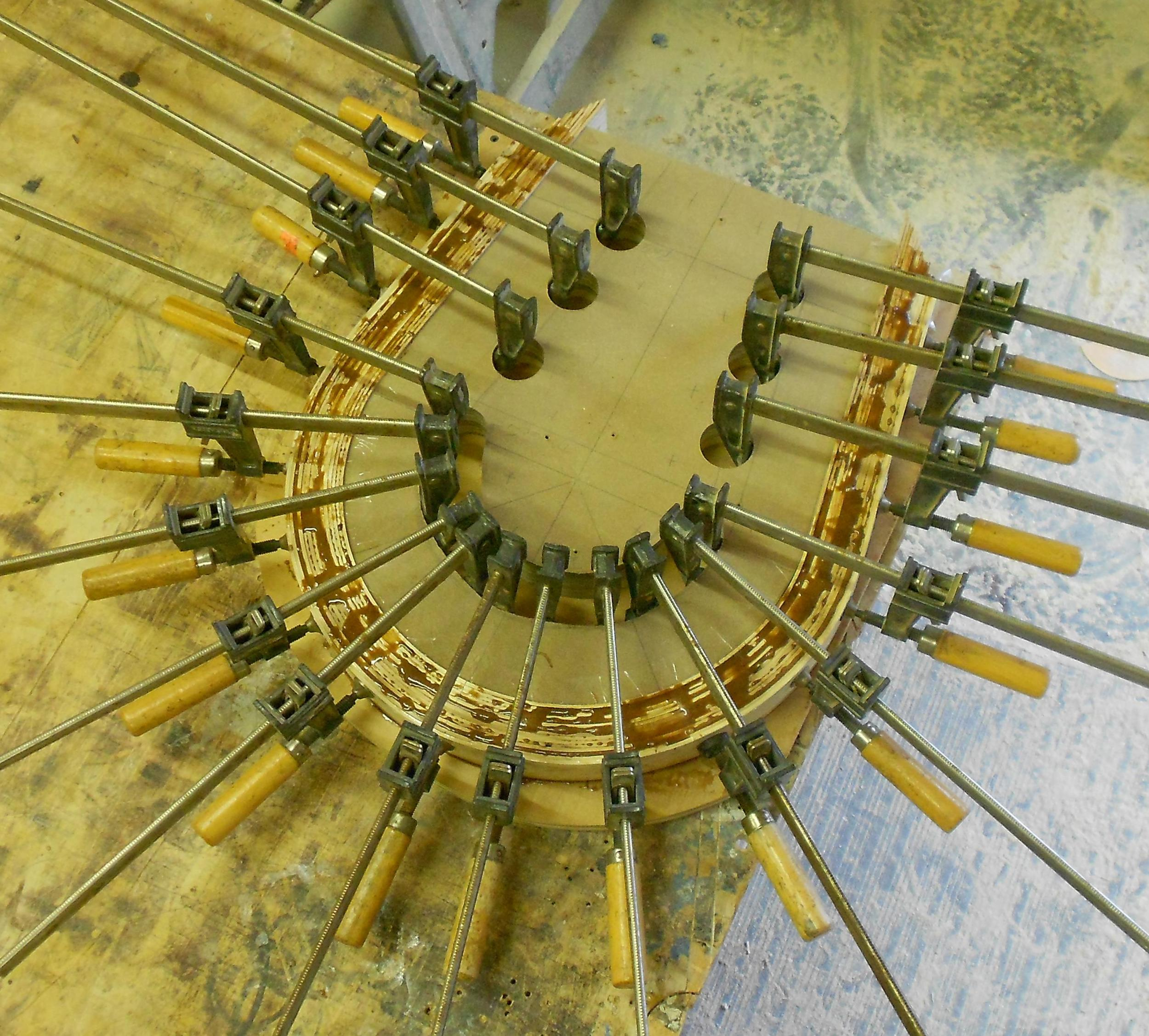 Brockport commission 4 one of the horse shoe bench parts in the glue up jig.jpg