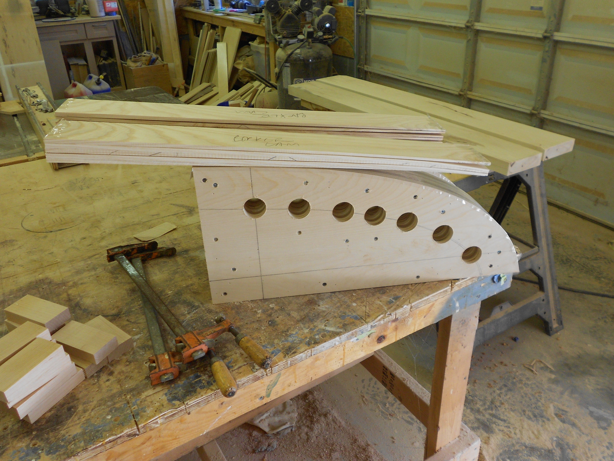 Brockport commission 2 tapered parts ready to be glued and bent around form.JPG
