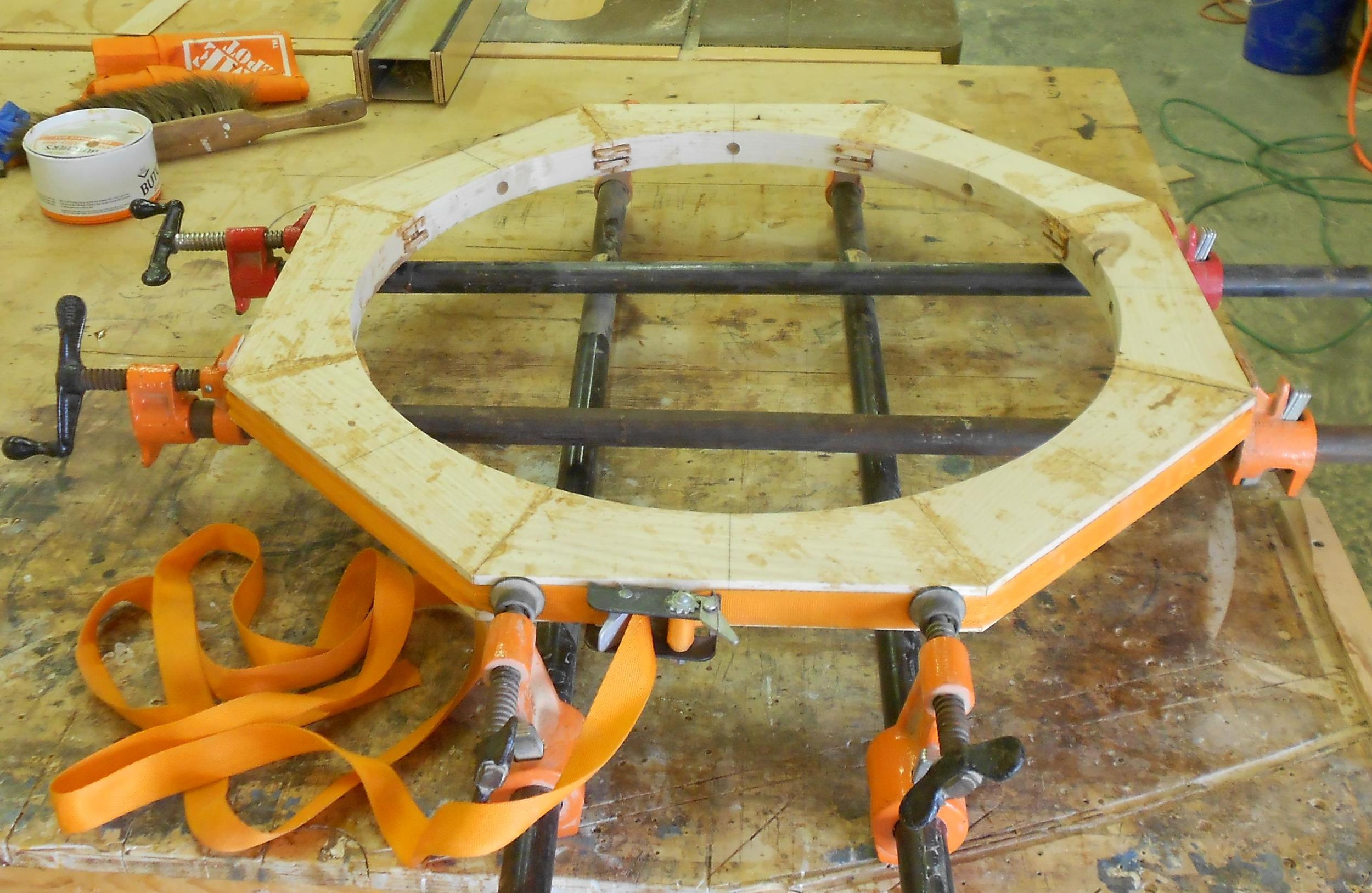 Brockport commission 11 joining the segmented circle top with exposed spline joinery.jpg