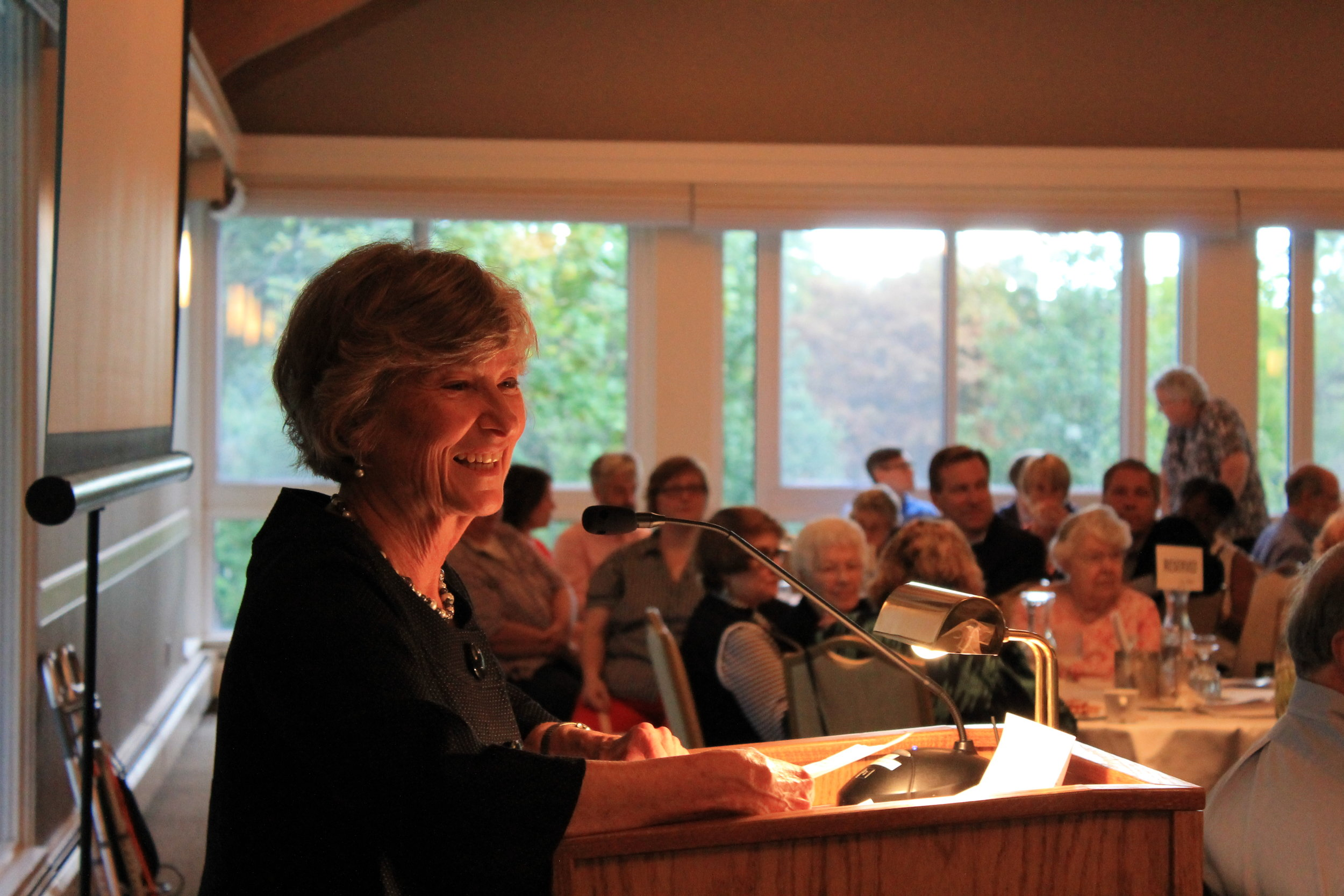 Board president, Joanne Pohl, speaking at the 2016 auction