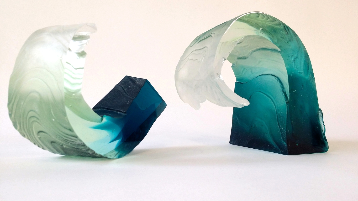 Layered sheets of textured wax curled and cast in Gaffer Glass.