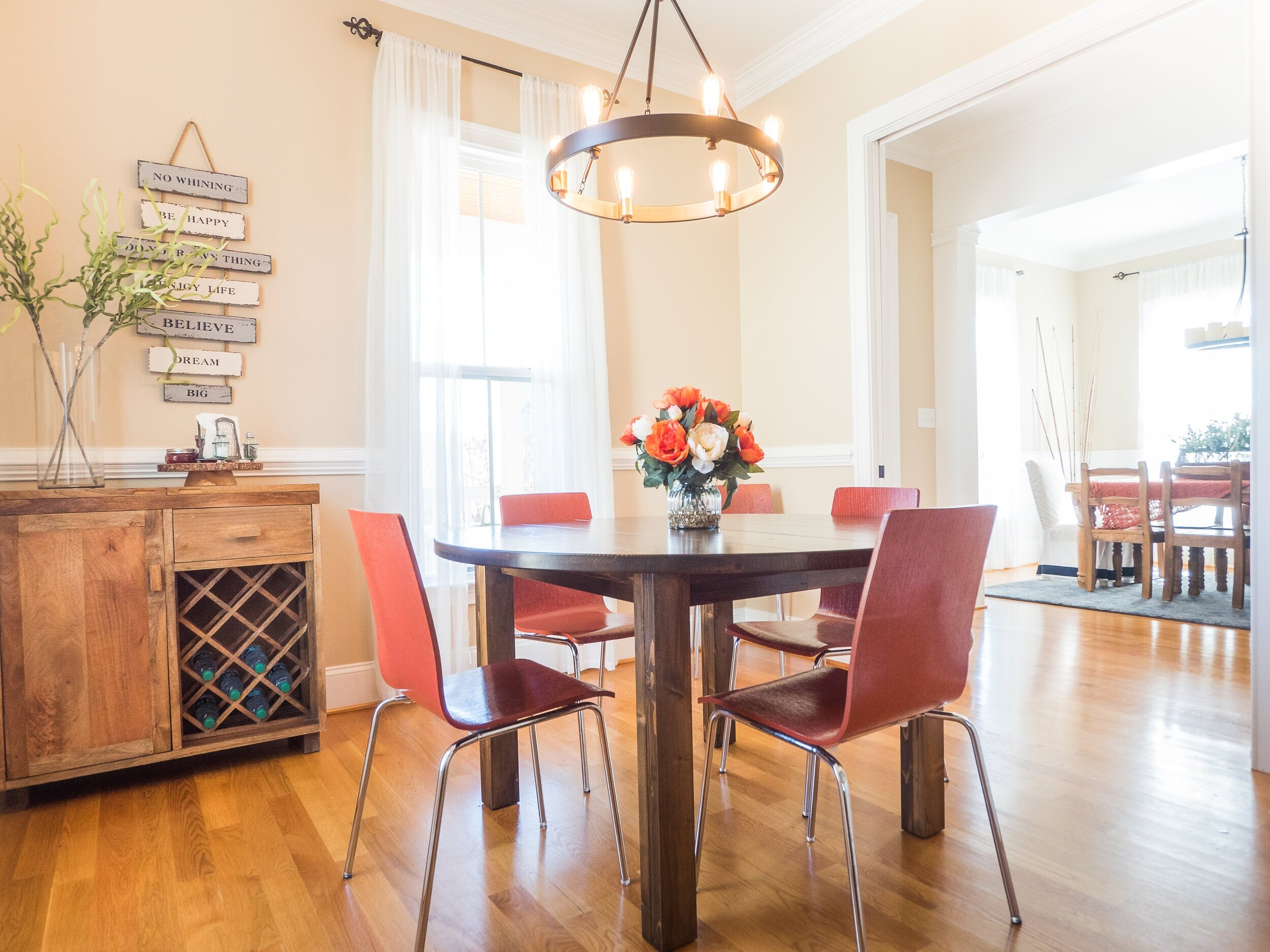 Existing wood dining chairs reused and custom painted to save money on new design.