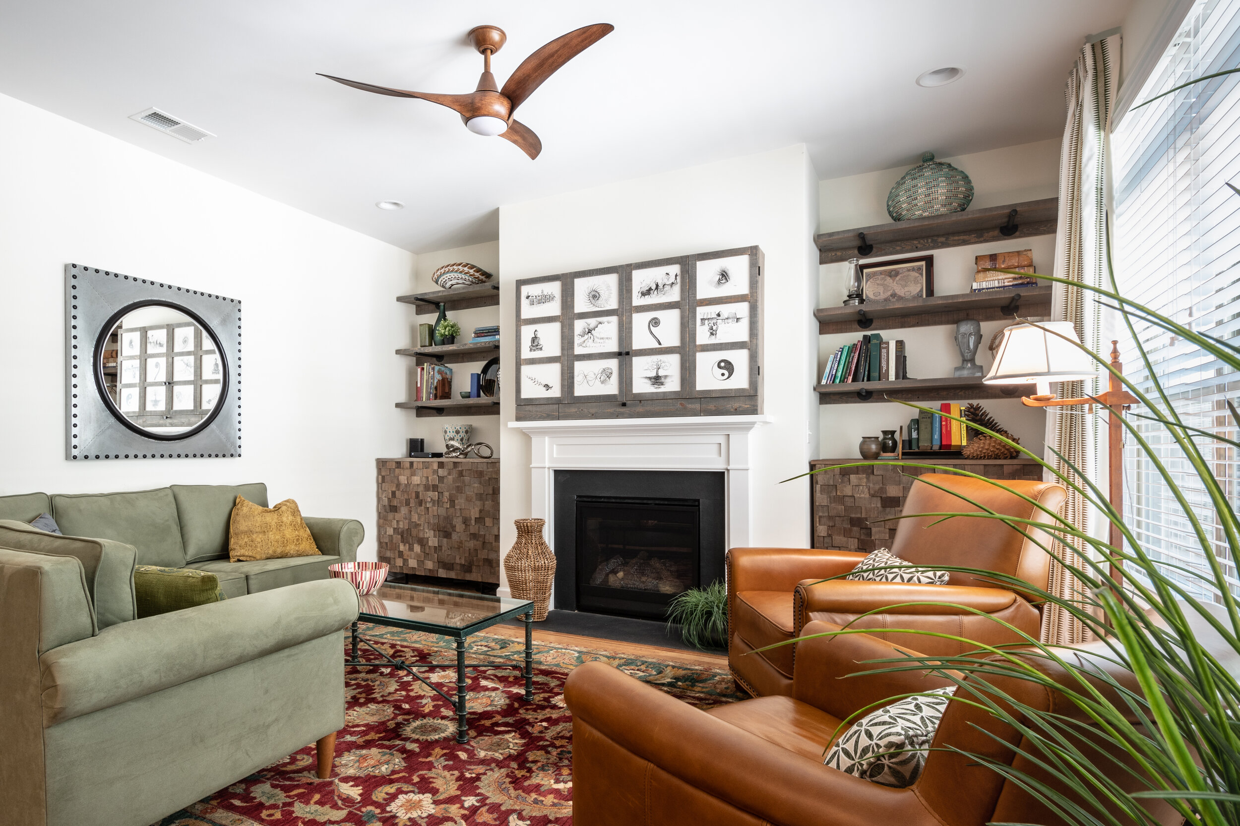 Living room with custom shelving and affordable accessories combined with homeowners collection.