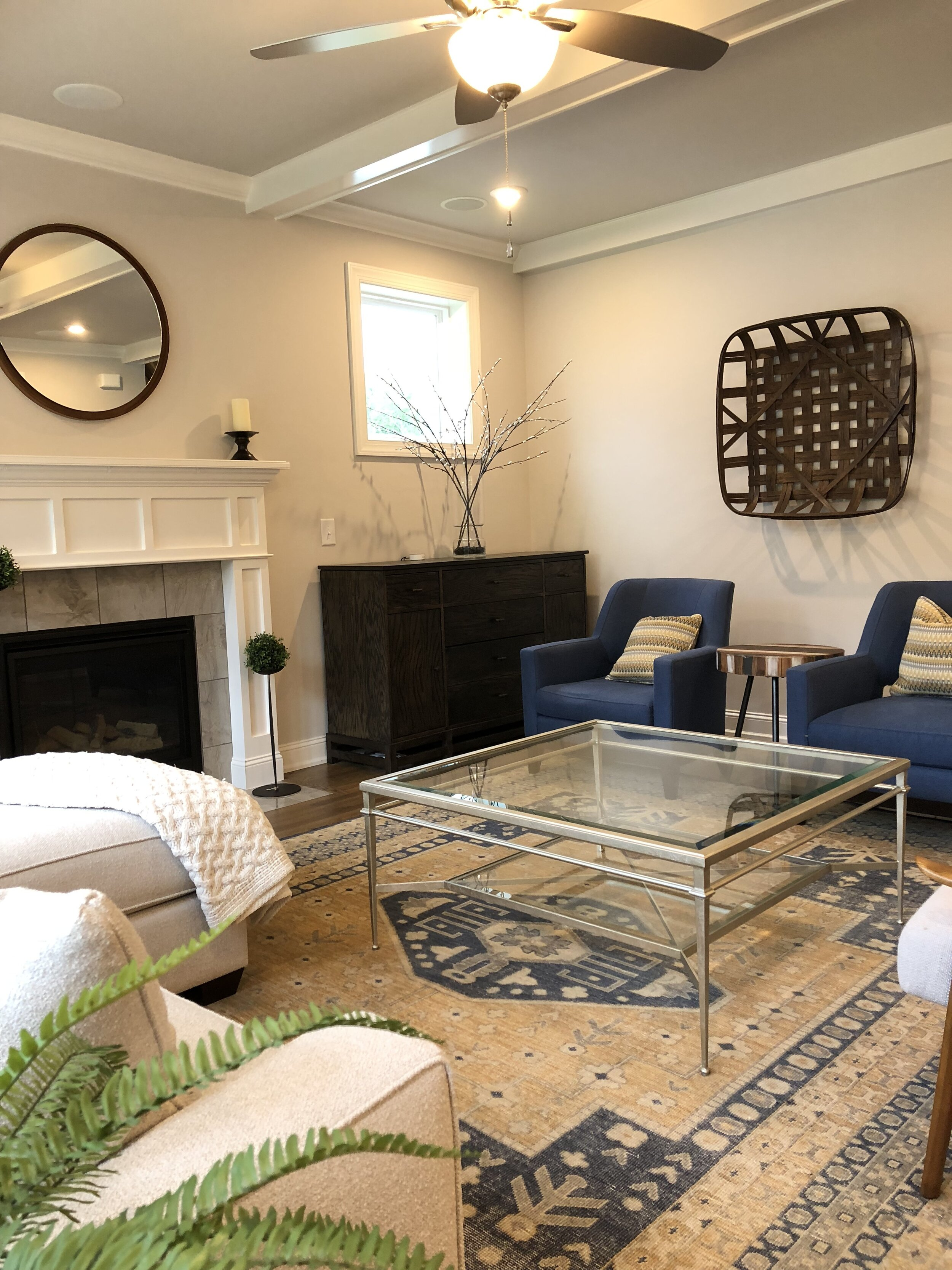 Mid-Century Living Room with Farmhouse Accents by First impressions