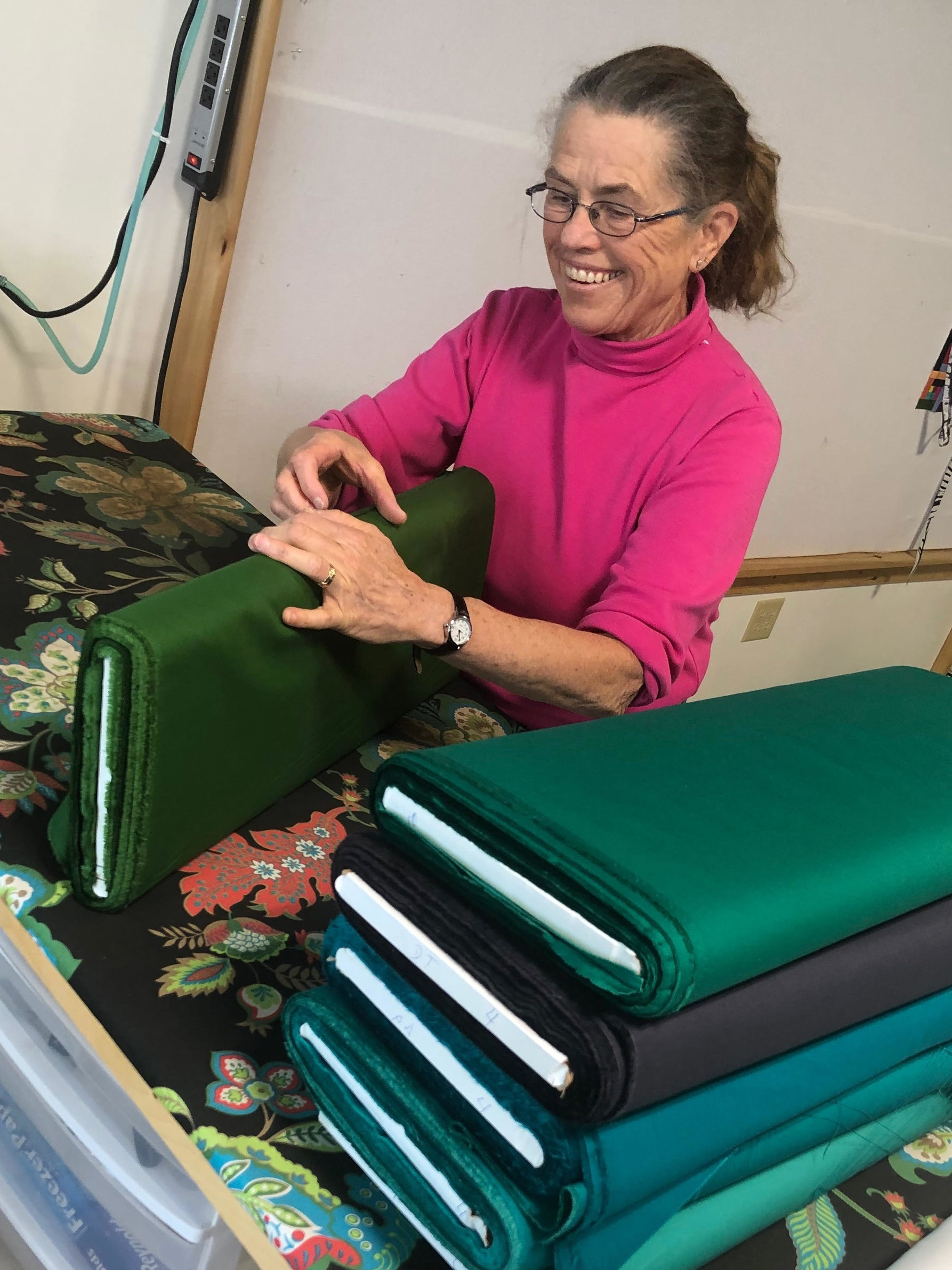 Carolyn Zanko getting the fabrics ready for cutting.