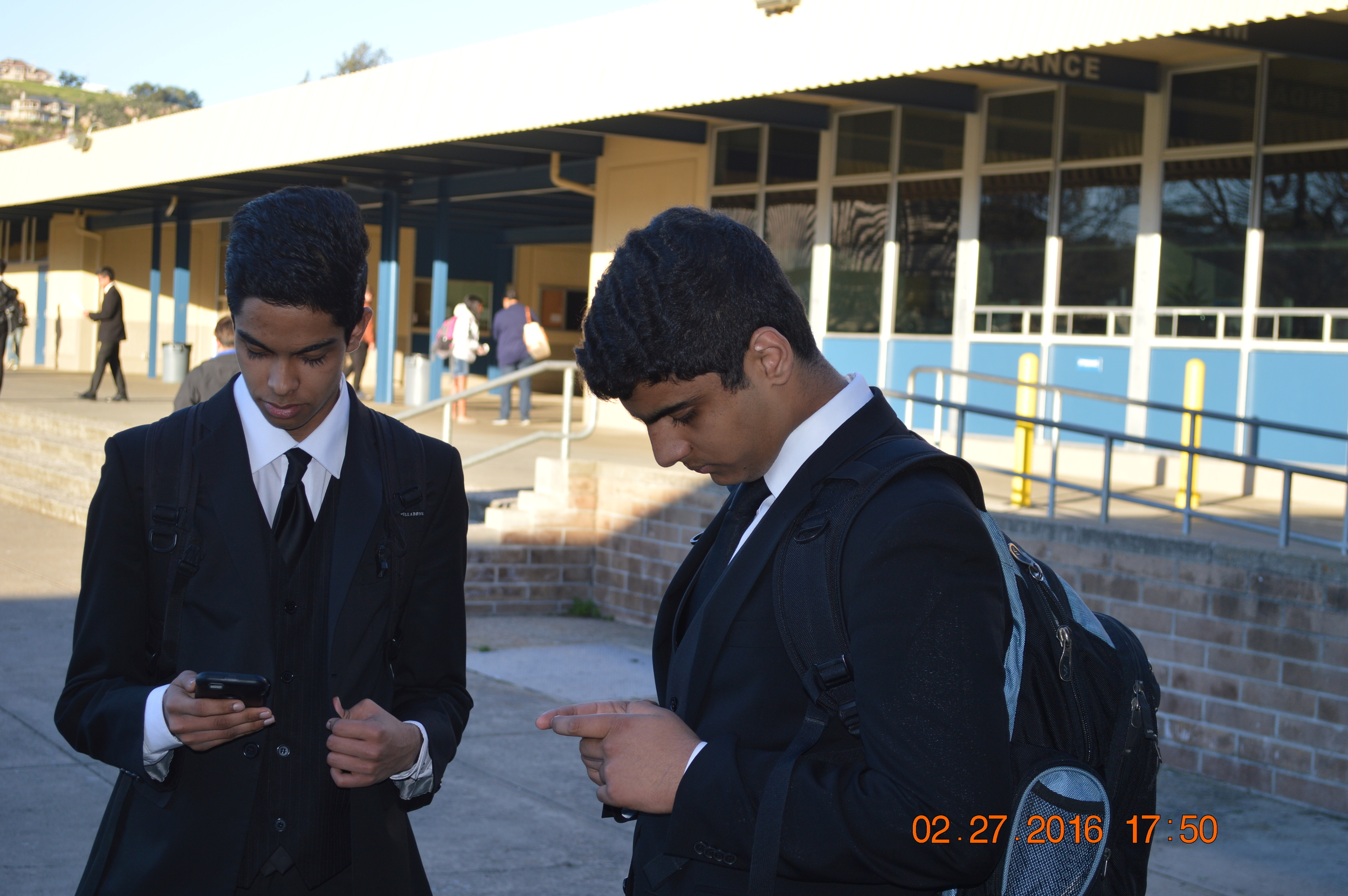 Partners Ismail Shaik and Pranav Govindaraju share a moment of anti-social phone using. Kids these days.....