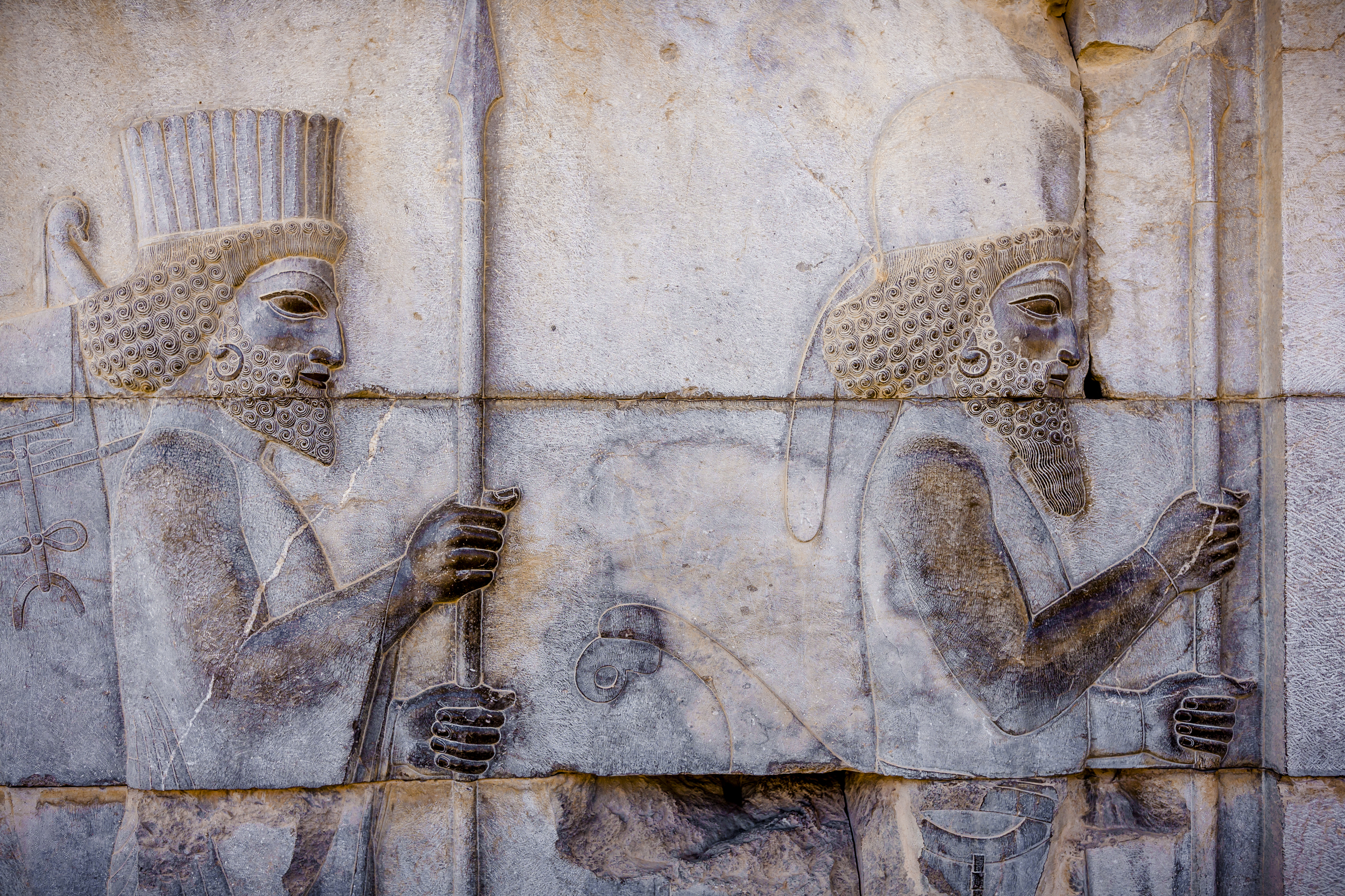Persian soldiers on the Staircase of All Nations at Persepolis, Iran. These ancient carvings were protected from damage by being buried.