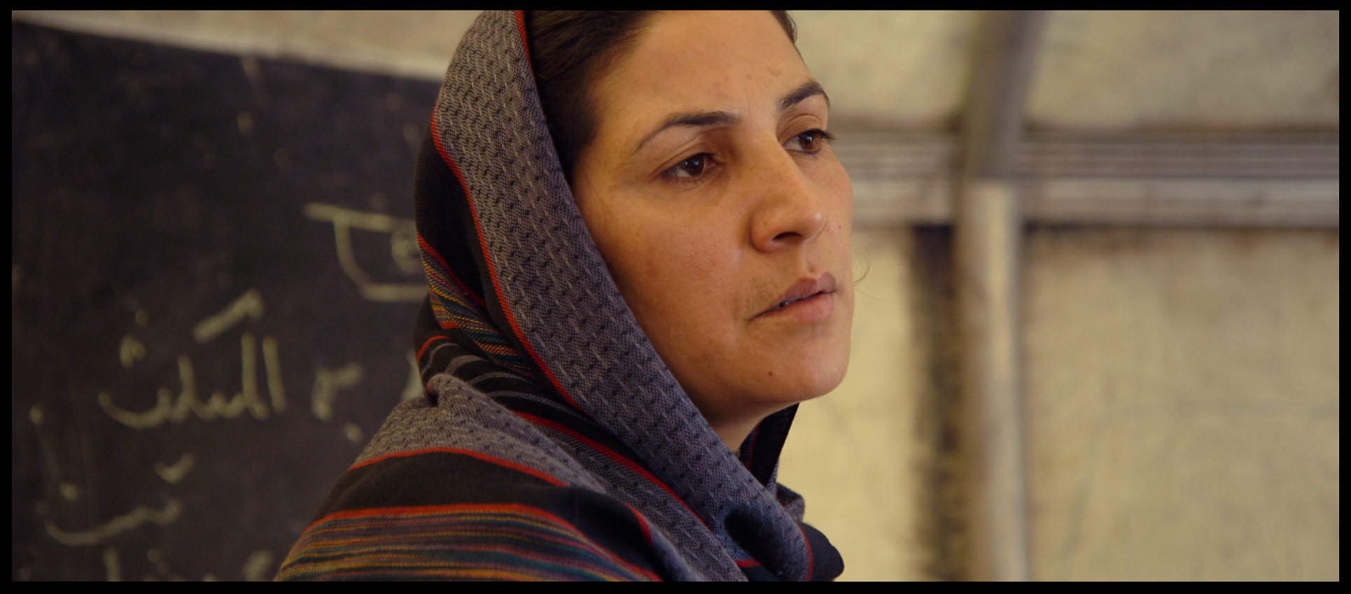 Film still: Teacher Fazula at the Daqiqi Balkhi school. Teacher Fazula's three oldest sons - Rostam, Sohrab and Yaldash - feature in Angels Are Made Of Light
