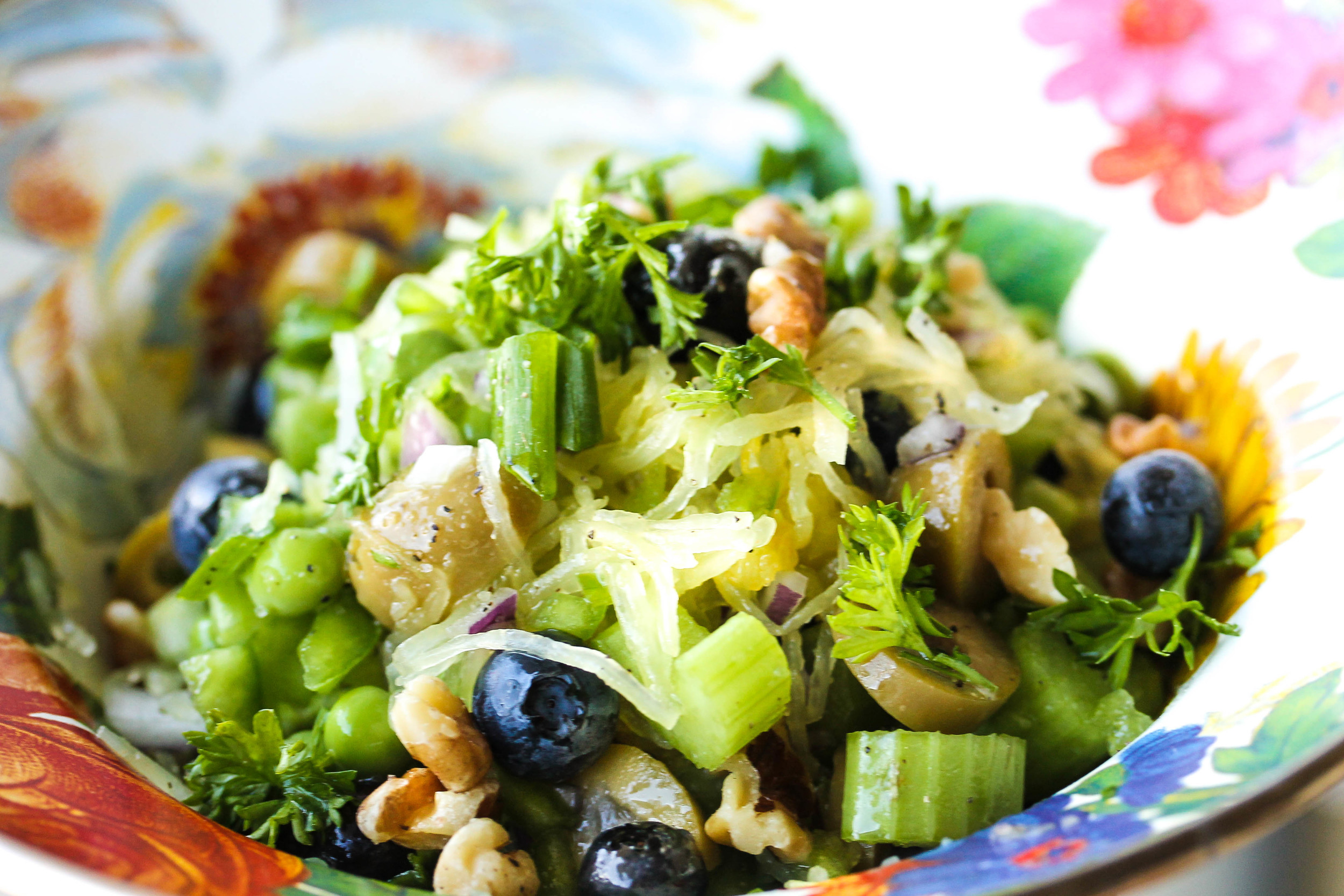 Slice celery,dice green pepper and onion, and mix with blueberries, peas, walnuts, and green olives. Gently mix with squash.