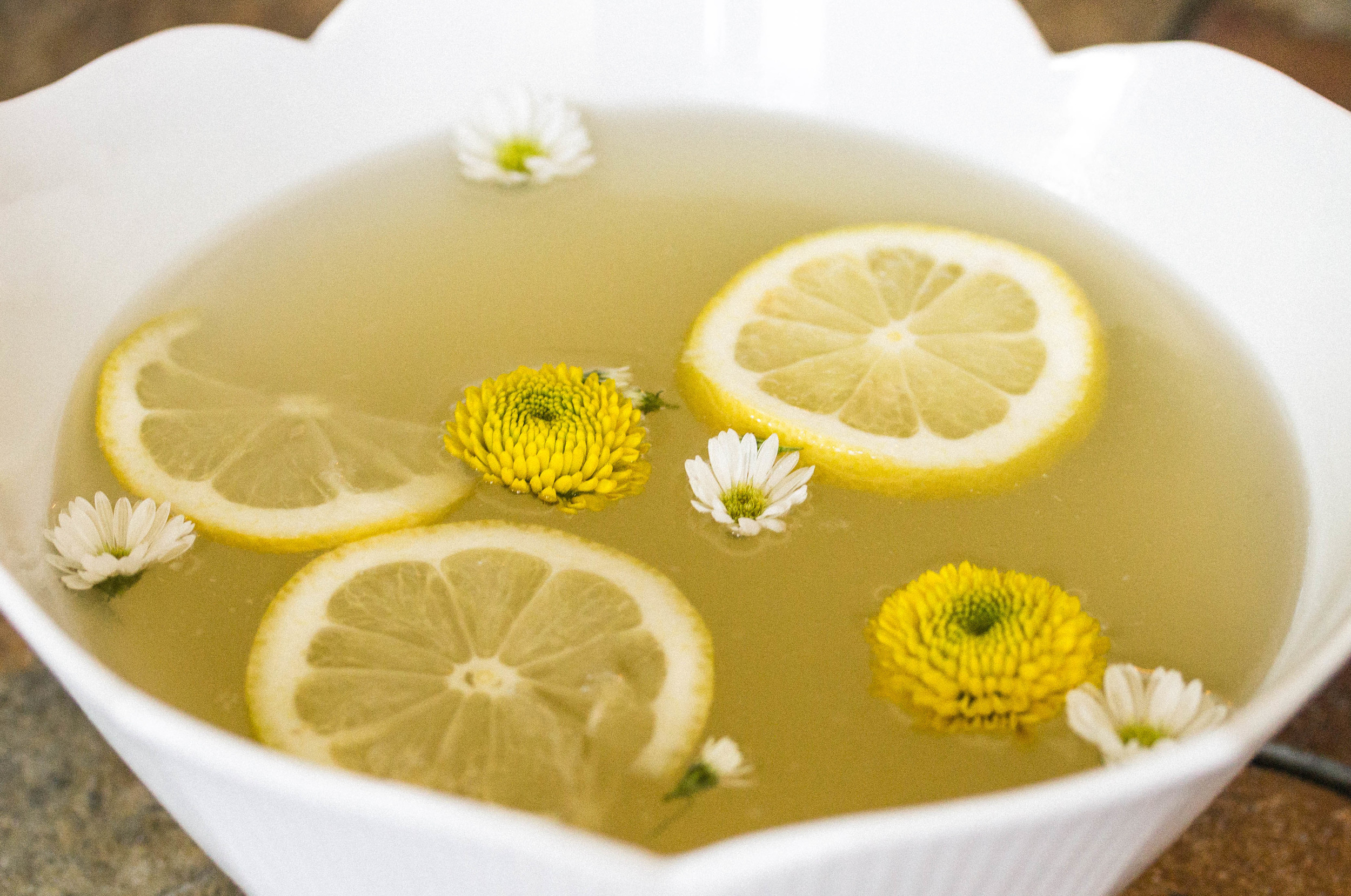 Serve broth with lemons and garnish with salt, pepper, and herbs to taste.
