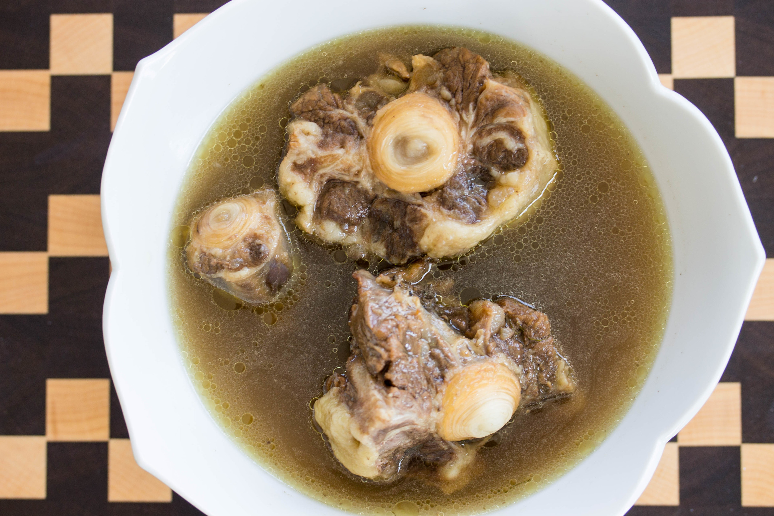 Strain broth into bowl and serve with oxtail.