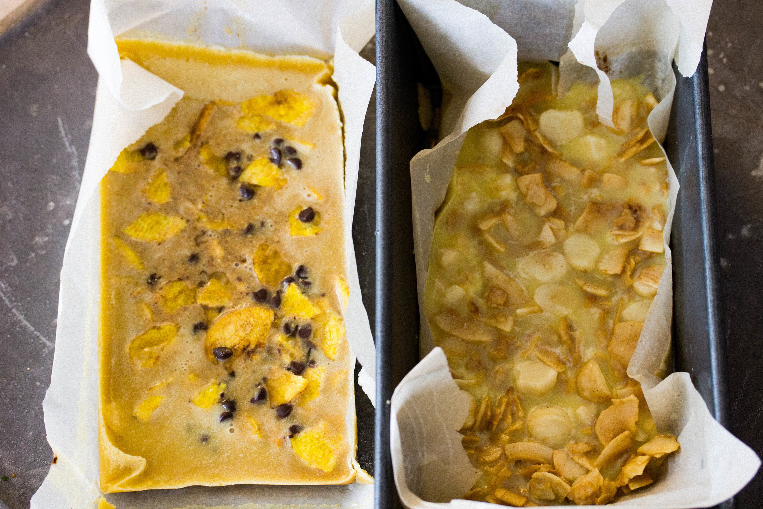Pour melted butter and oil into loaf pan lined with parchment paper, then add toppings and freeze until well formed.