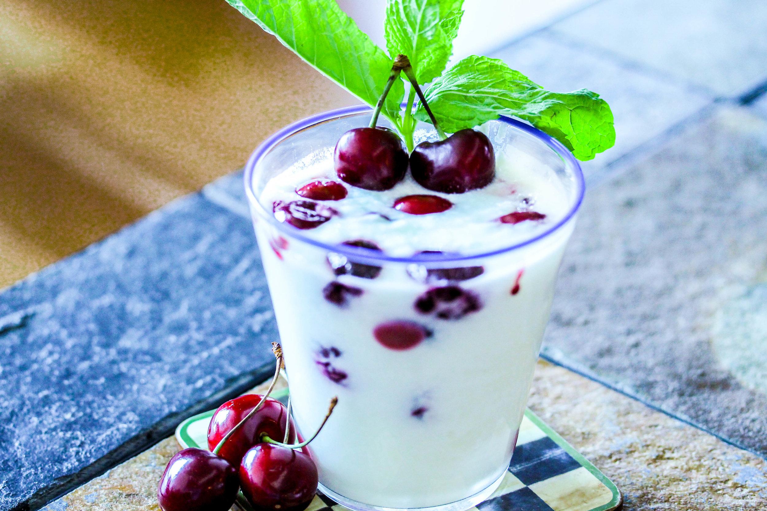 Homemade yogurt with oven roasted cherries