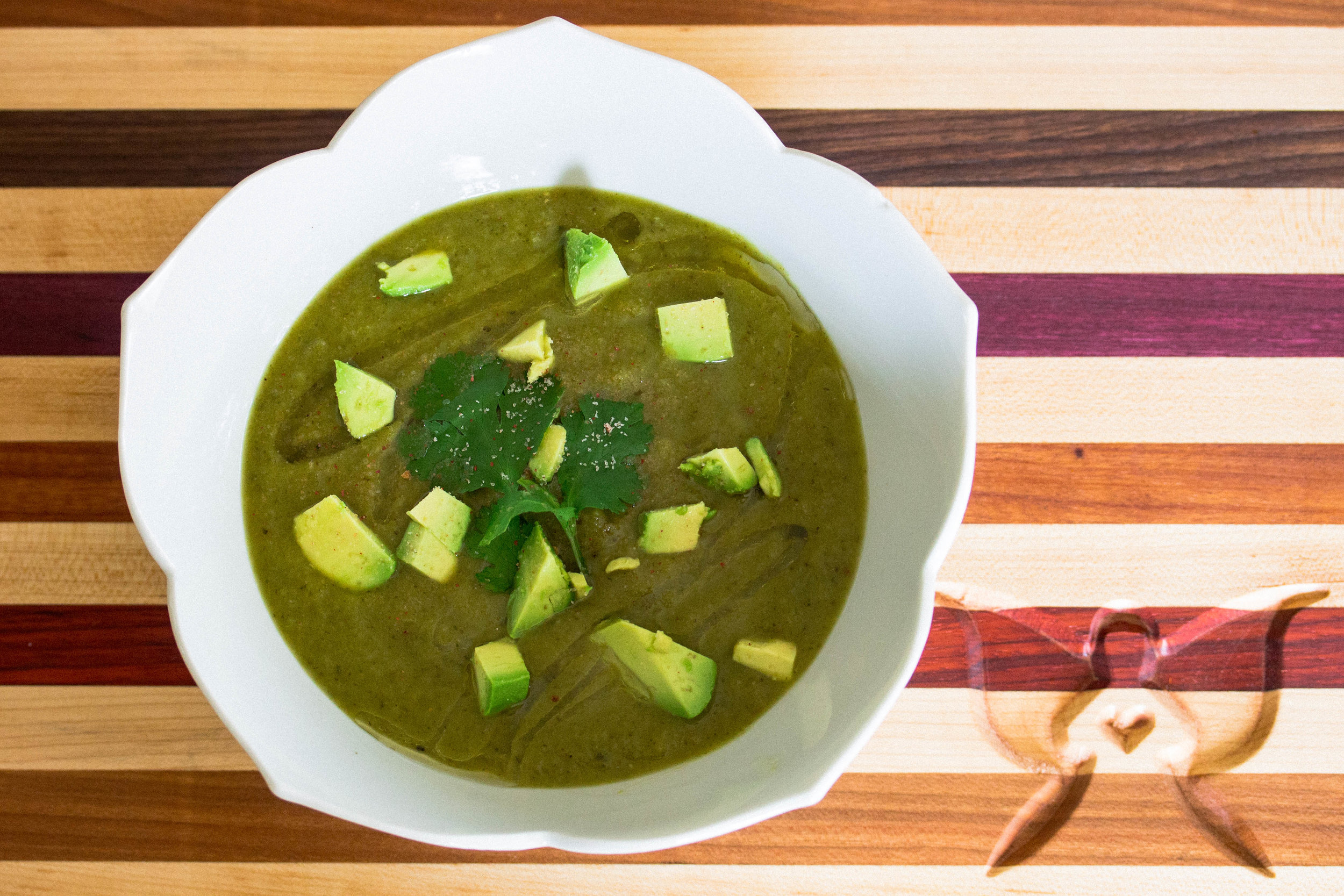 Pure soup and serve garnished with avocado and cilantro.