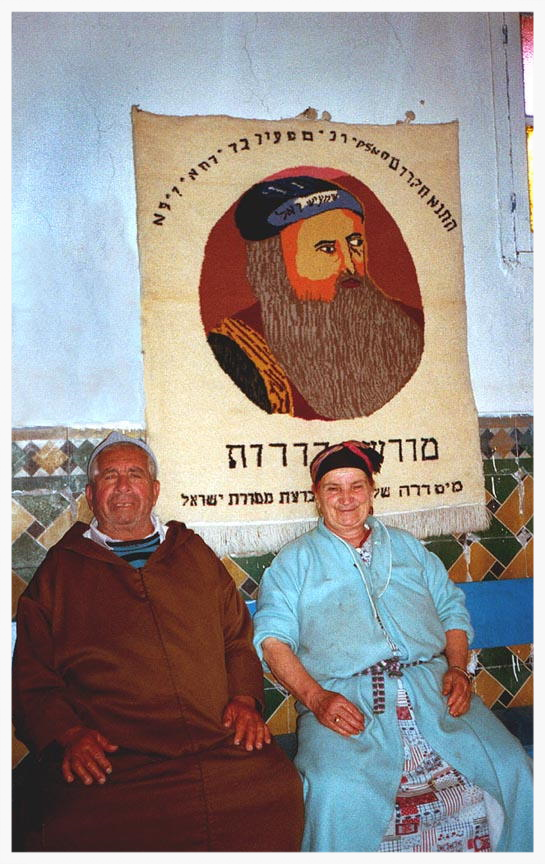 Yamna and Hananiyah Elfassies told the story of why they stayed in the Ourika Valley. They remained in the Ourika Valley to protect the tomb of Rabbi Shlomo ben Hensh, decades after all the other Jews left. Rabbi ben Hensh died more than 500 years ago, but they revered him as a Tzadik who lived after death, stopped the sun's course, and even turned into a snake to ensure himself a proper Jewish burial. Because of a recurring dream they shared, in which a snake became a staff blocking their path, the Elfassies were afraid to leave the gravesite. The Tzadik's tomb is said to be the source of miracles.