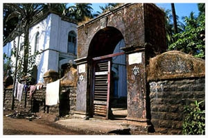 Though the pictured Alibag synagogue dates from 1848, some say that for at least 800 years, the Bene Israel have prayed to the Jewish G-d in this village, three hours south of Bombay on the palm-bedecked Konkan Coast. The benches creak and the air hangs heavy in the mildewed Magen Aboth sanctuary. Nonetheless, each day, the old community members gather for prayers, and on Shabbat collect a minyan from the 8-10 Jewish families left in town.