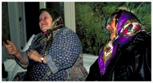 """There was a hole in the ground, and we lived in it,"" says Vera Shvartsman Cheyved (left), remembering how she survived the Holocaust in Bershad. She remembers singing Yiddish songs to the doctor in the hospital after she was struck by a bullet. Today, she is still singing whenever she receives visitors, like Brukha Feldman (right), another Bershad native."