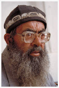 """Malkiel Ashurov Levy worked 55 years for a Communist government shoe factory. When the Communists lost power, Malkiel's pension lost its value. Now his clothes and histubeteika(traditional Bukharian cap) are filthy and he gets his groceries from the American Jewish Joint Distribution Committee. Not to suggest conditions were rosy during the Communist period: """"We locked the doors to celebrate the Jewish holidays,"""" Malkiel remembers. """"The non-Jews said we made matzah with people's blood,"""" he says, recalling the """"Blood Libel"""" common throughout the Former Soviet Union and elsewhere. """"The government took all my grandfather's things in 1929 -- 15 wagons of his belongings. He fled and my mother was taken to prison."""" After a pause, Malkiel asks, """"Will you take me to prison because of this interview? Who will read this?"""""""