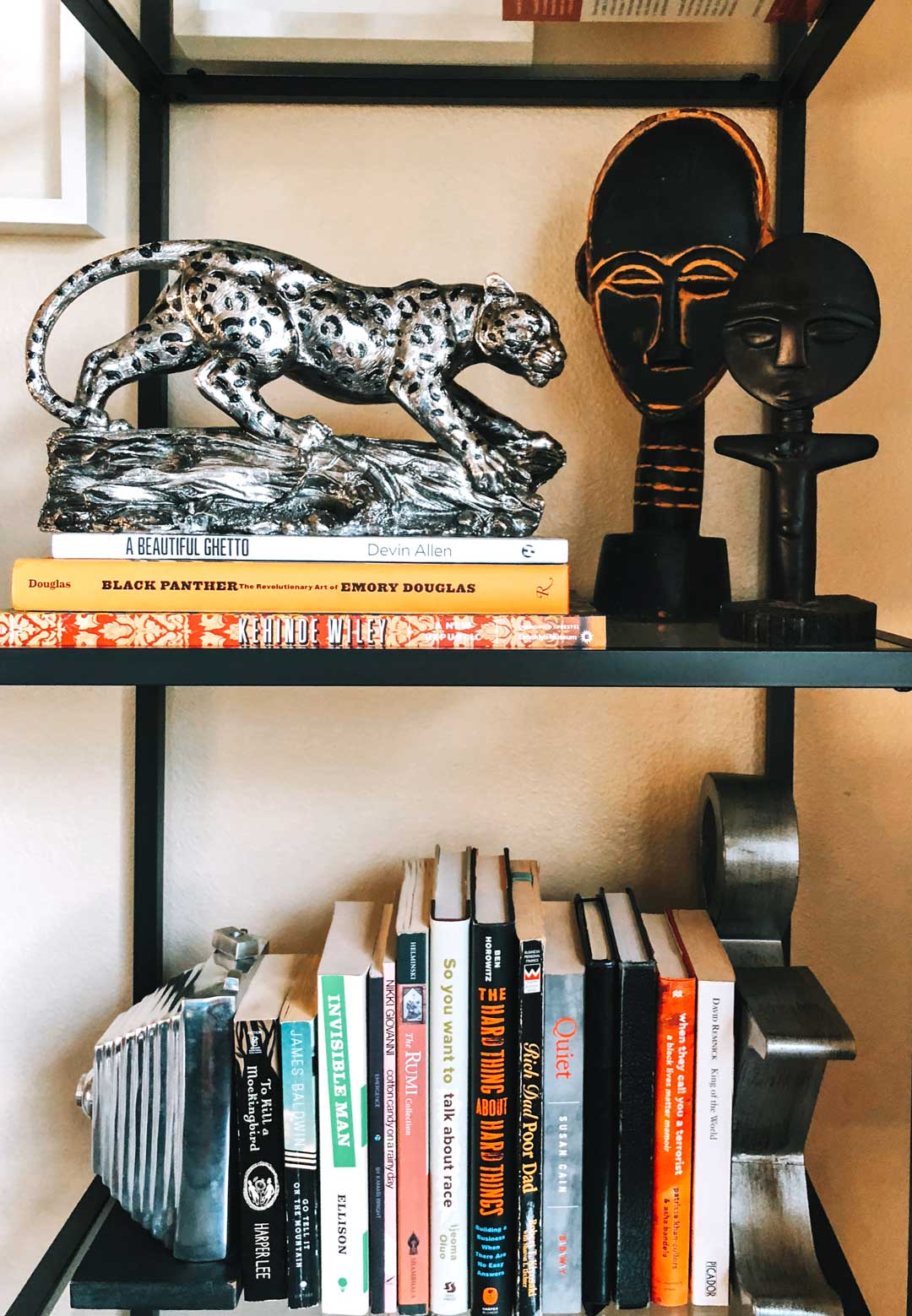 Gold chrome vase, cougar statue & bookends: Ross. African statues: Goodwill.