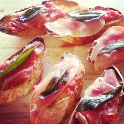 Tapa of tomato rub, jamon and crispy sage leaf