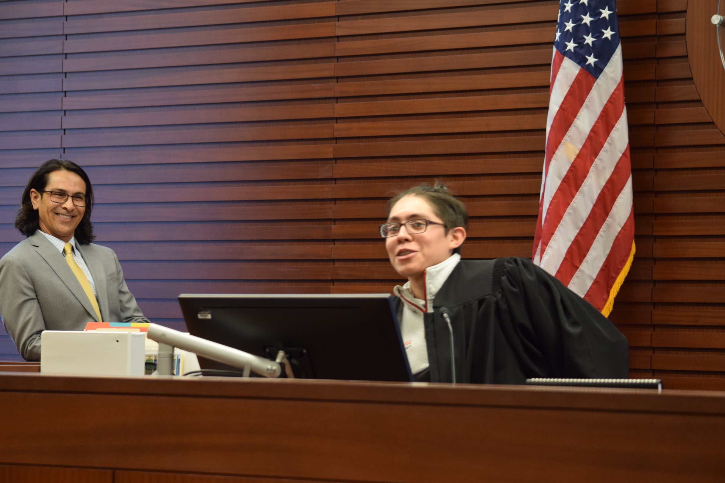 A SVUDL student dresses in Judge Francos' black robes and sits from his bench. During the visit to the courthouse, SVUDL members were able to learn more about the inner workings of a courthouse and the world of judges.