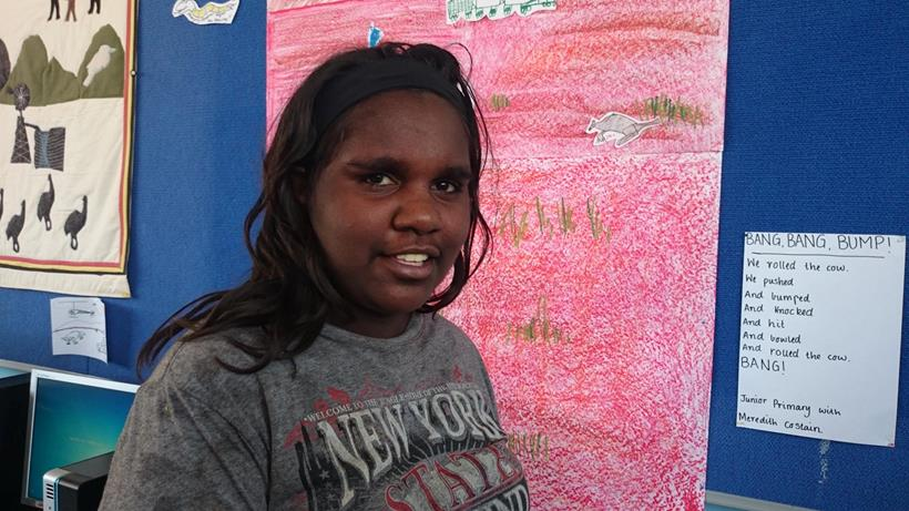 Tamika being fitted with hearing device at Yandeyarra